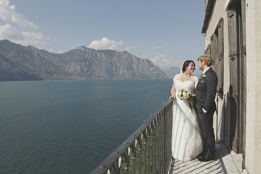 Bride and groom portrait with Lake Garda view