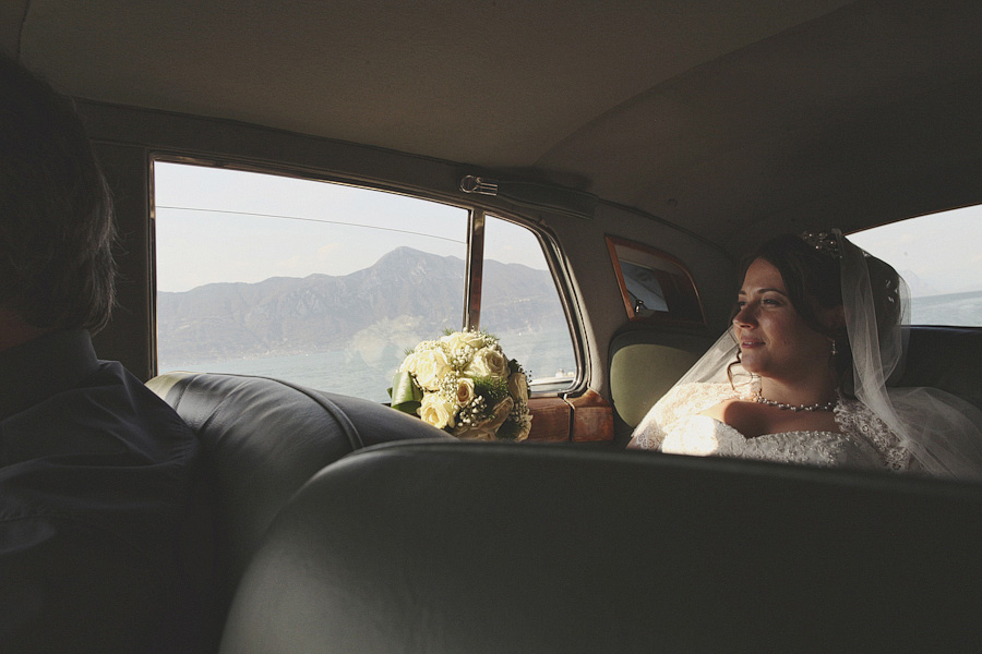 Bride in wedding with Lake Garda in background