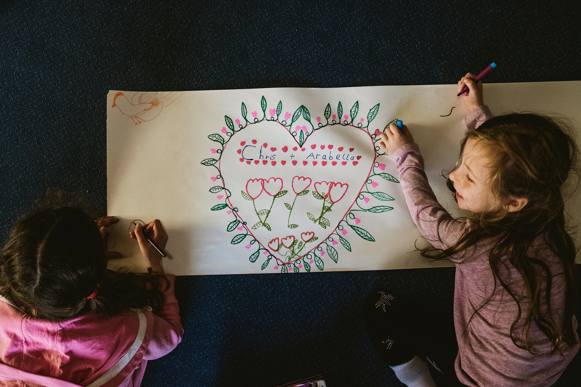 Photograph of children drawing during Lineham Farm wedding preparations