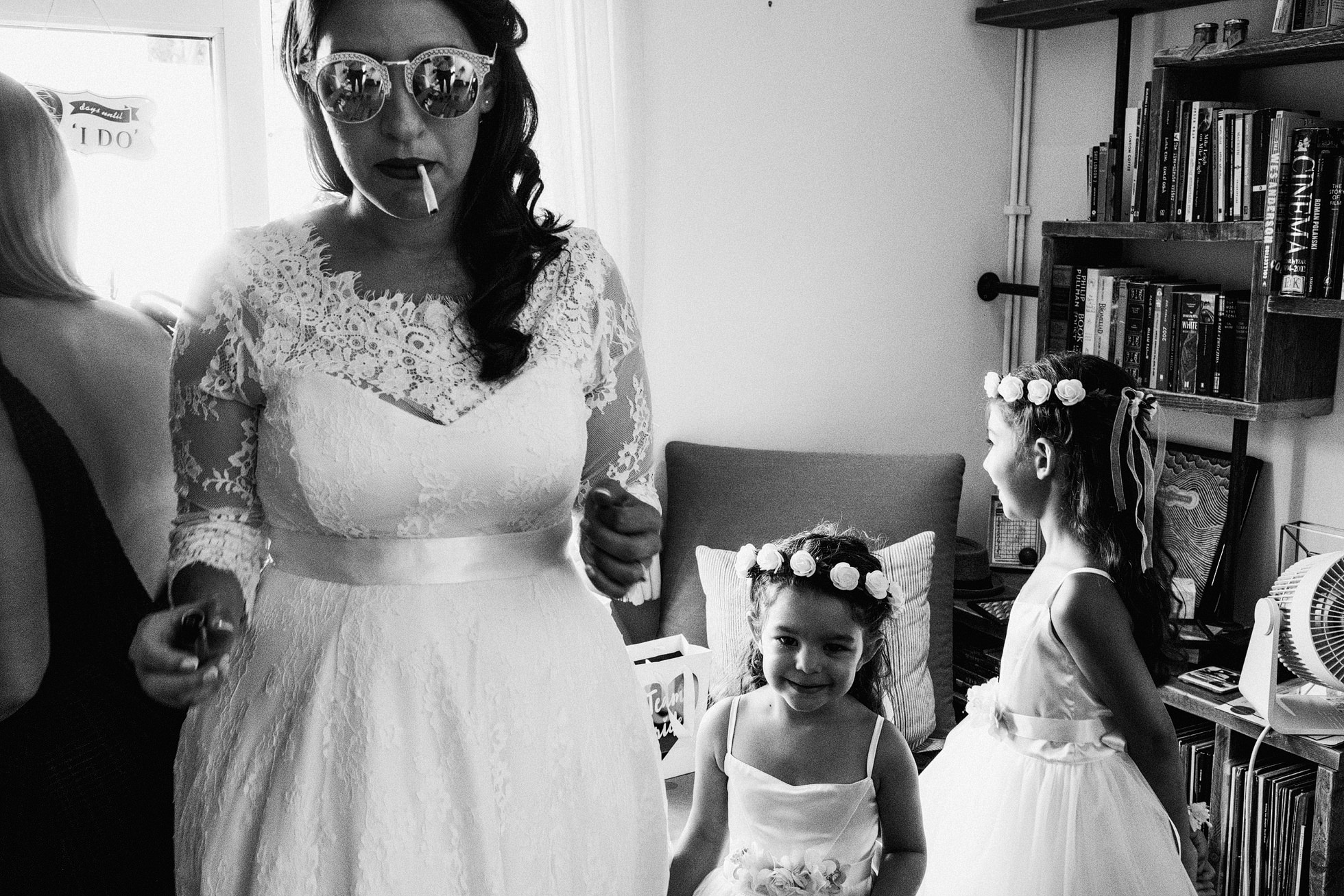 Bride with sunglasses and flower girls