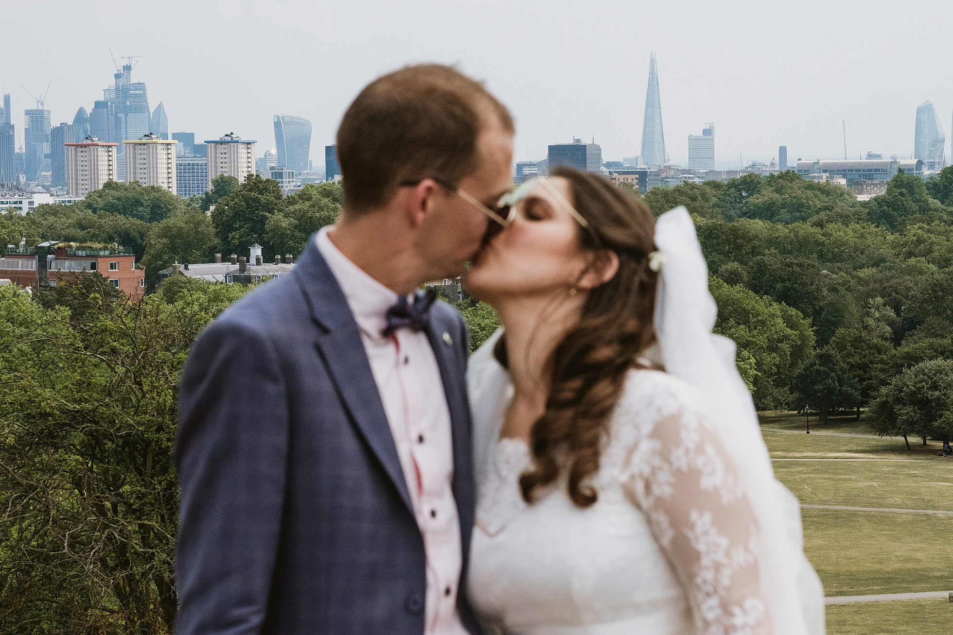 Bride and groom with London skyline