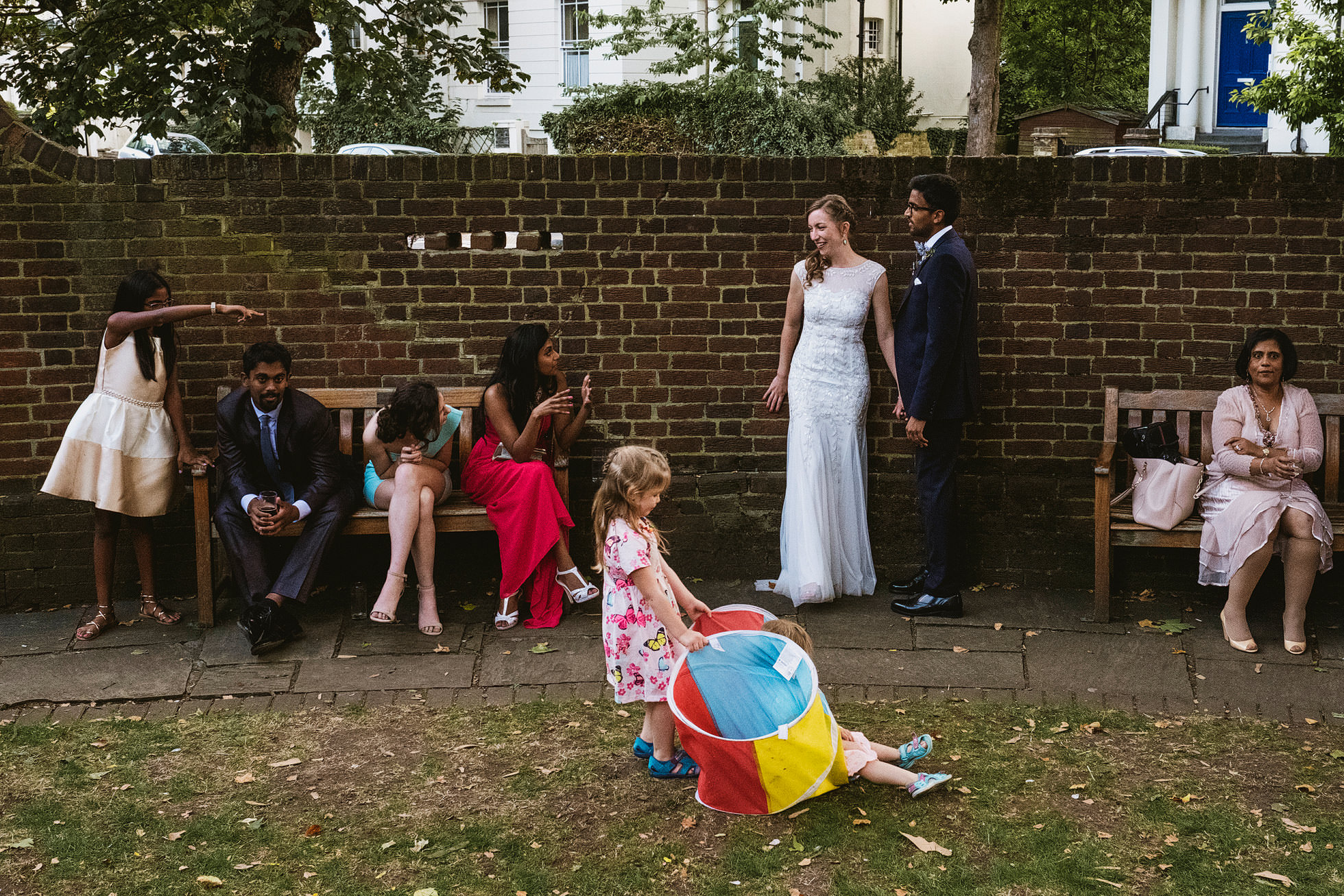 Documentary wedding photograph of Bride and groom and wedding guests at Cecil Sharp House
