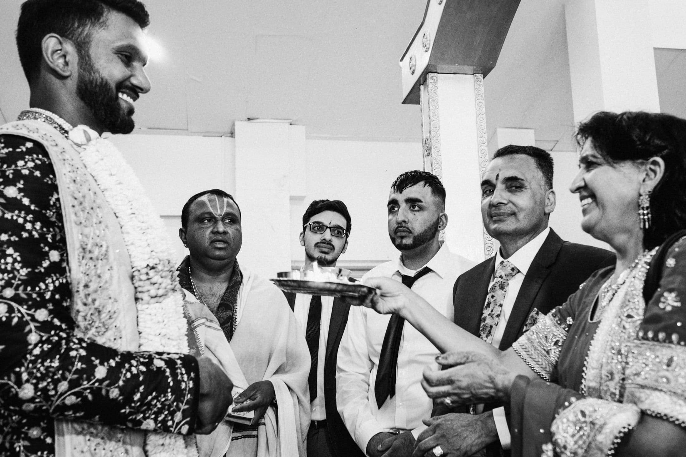 Black and white indian groom ceremony at Shri Venkateswara Balaji Temple