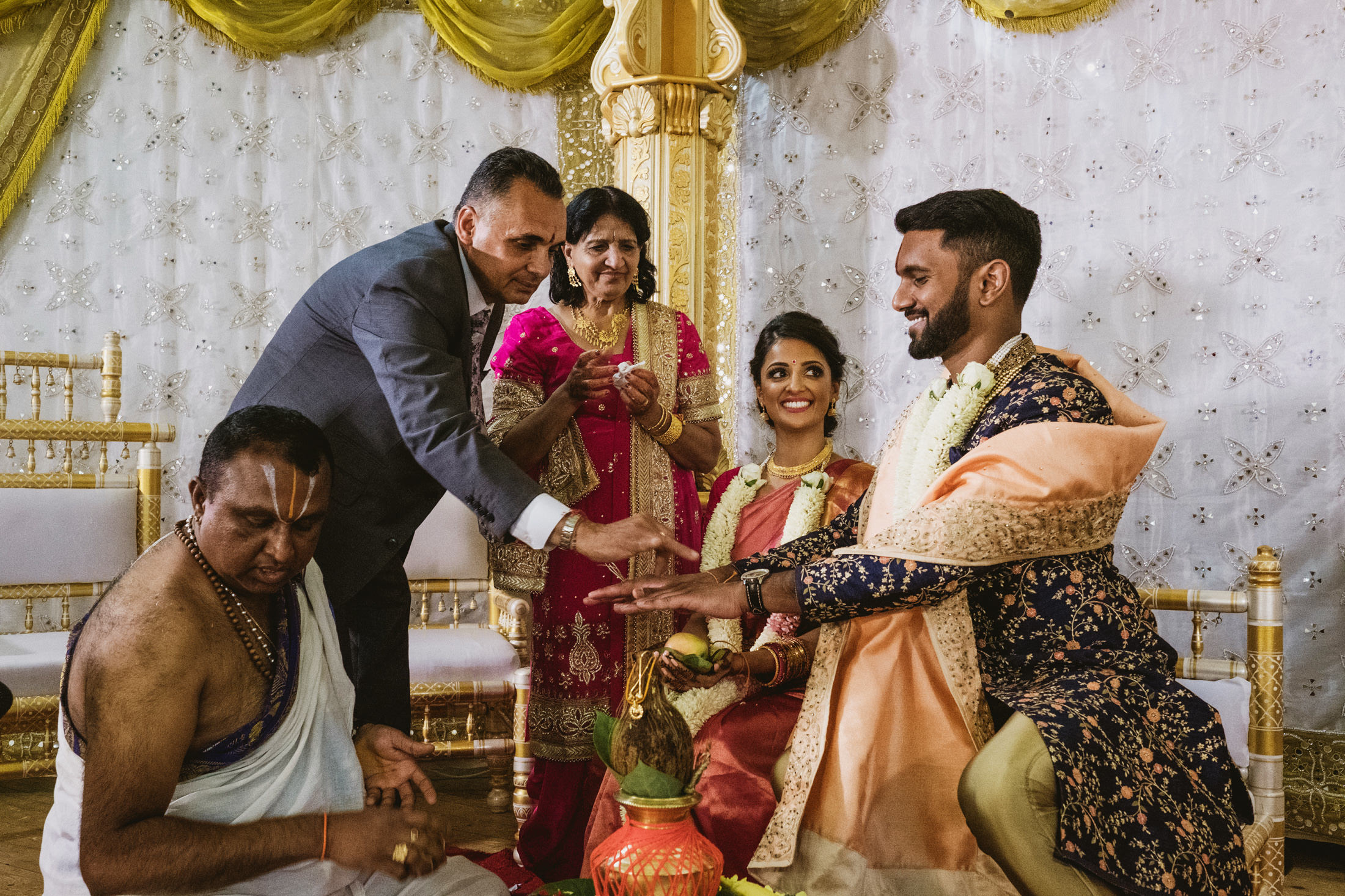 Bride and groom with family in Indian ceremony