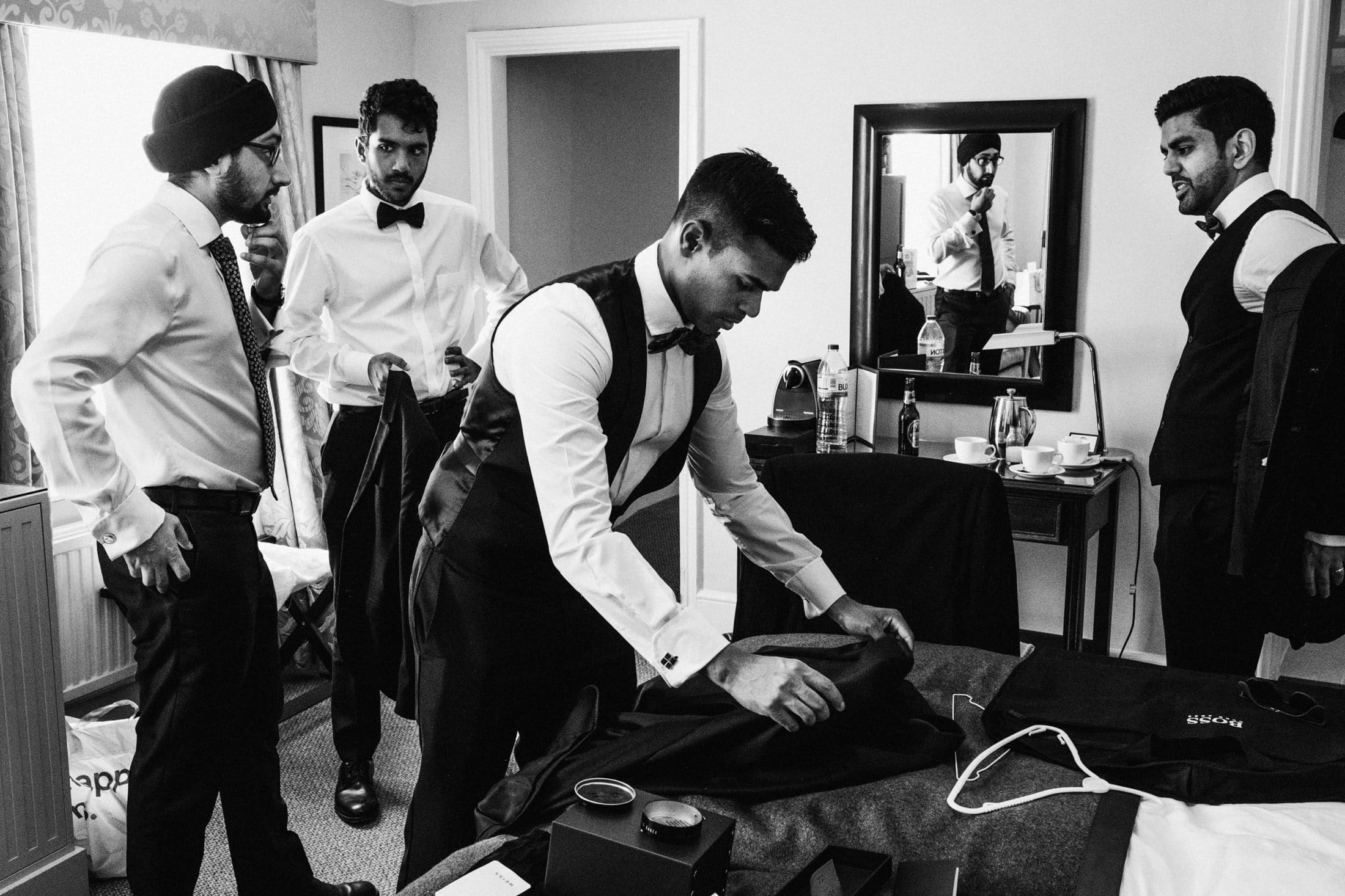 Groomsmen getting ready in Macdonald Bear Hotel