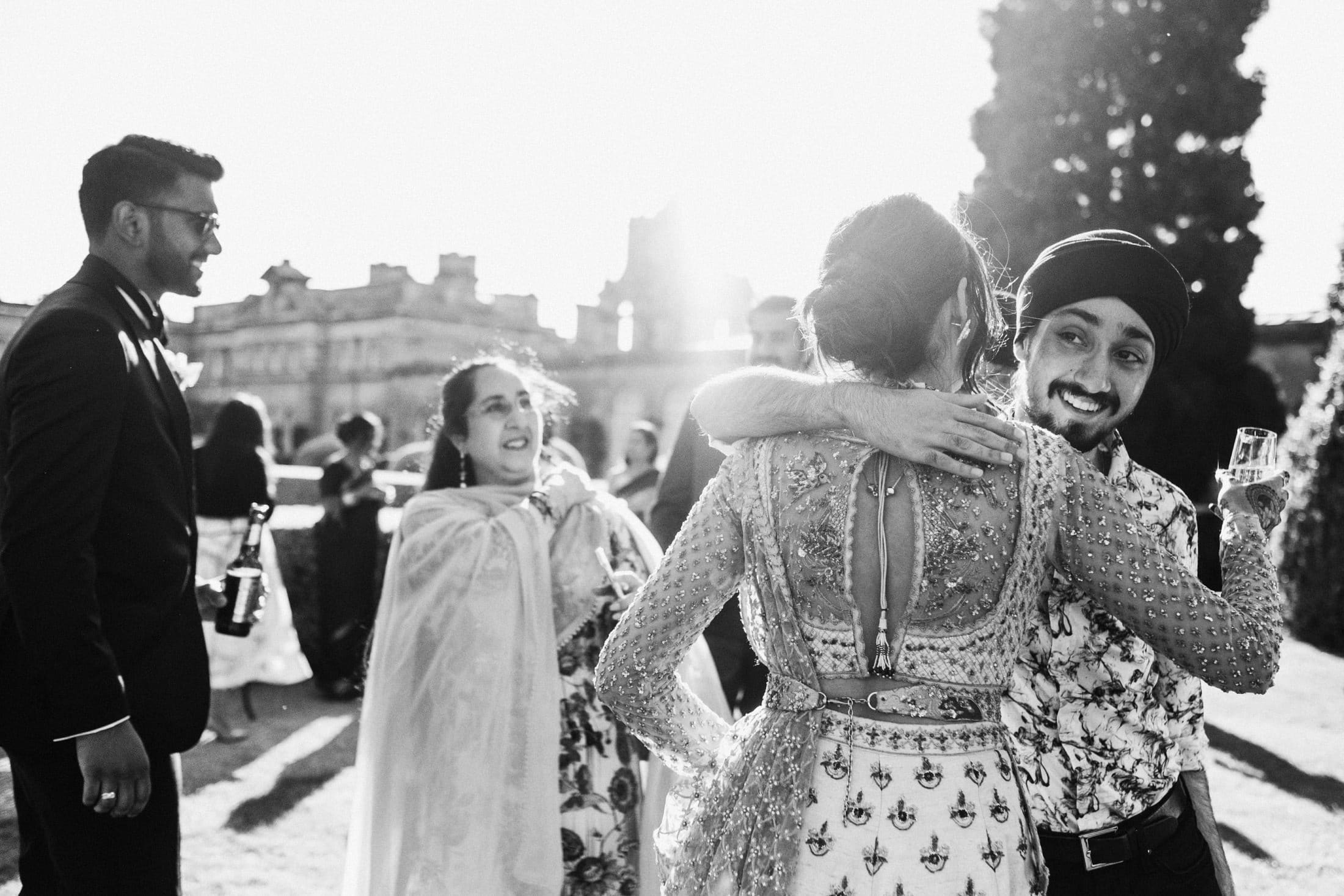 Bride hugging guests at Blenheim Palace