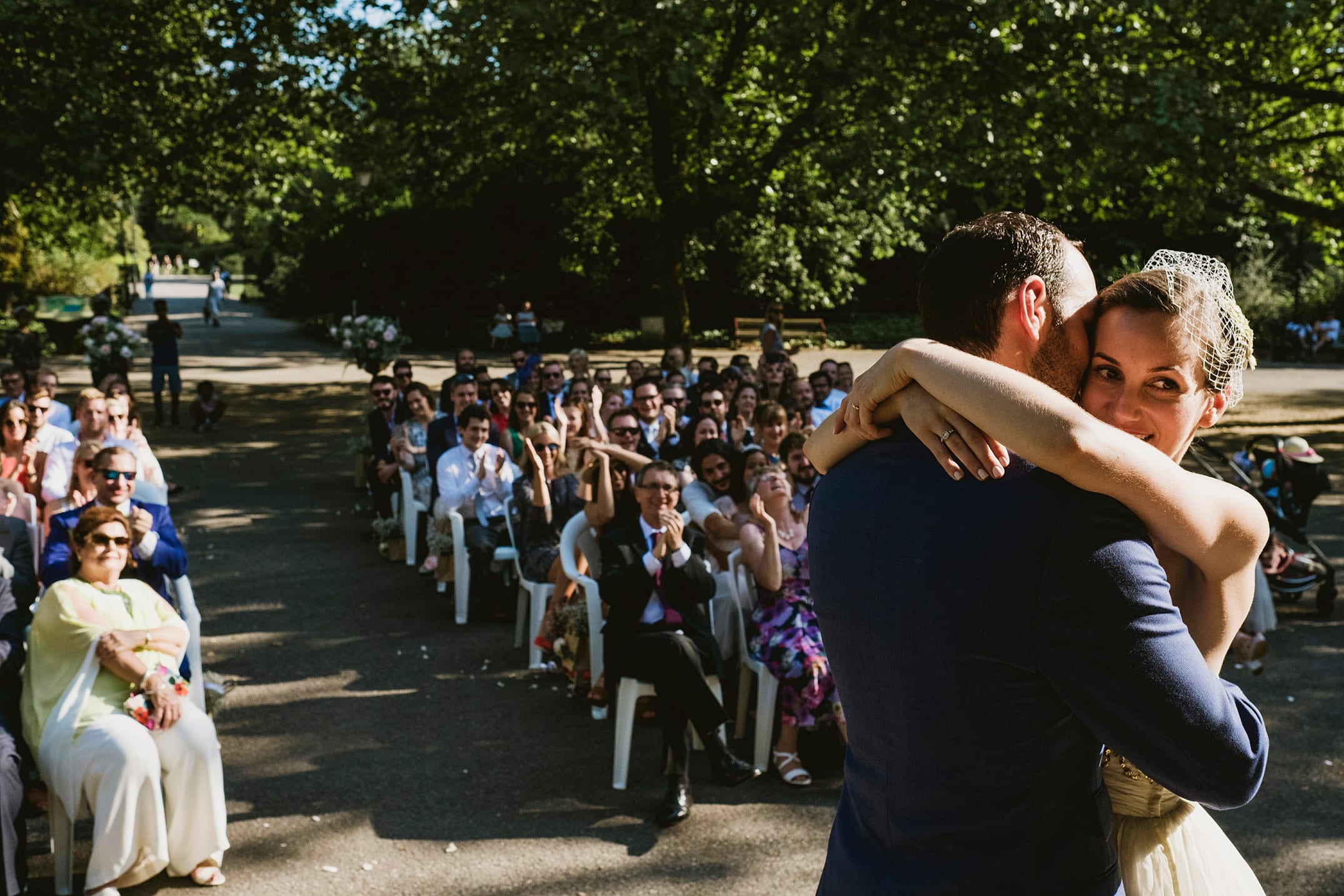 Battersea Park bride and groom ceremony first kiss