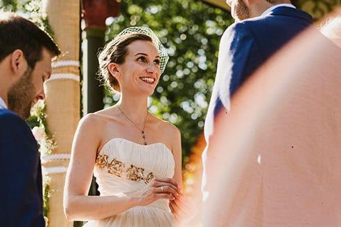Battersea Park wedding ceremony bride and groom exchanging rings