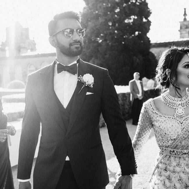 Blenheim Palace Wedding Photography. Bride and Groom arrive to reception arm in arm.