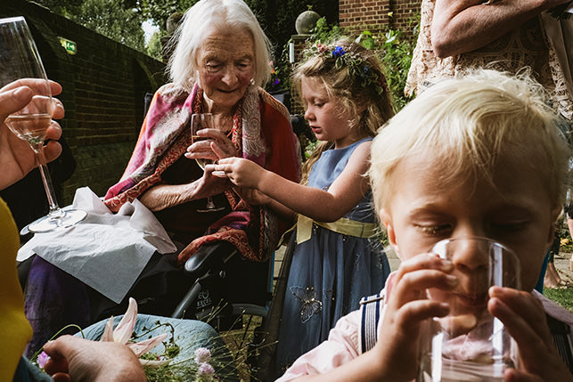 Cecil Sharp House wedding guests grandma and children drinking