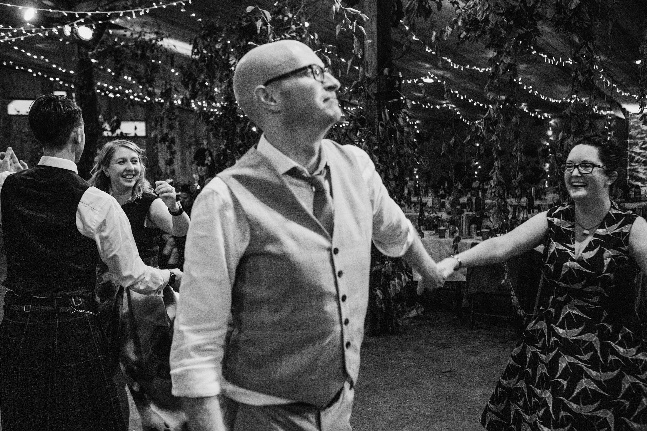 wedding guests dancing at Comrie Croft
