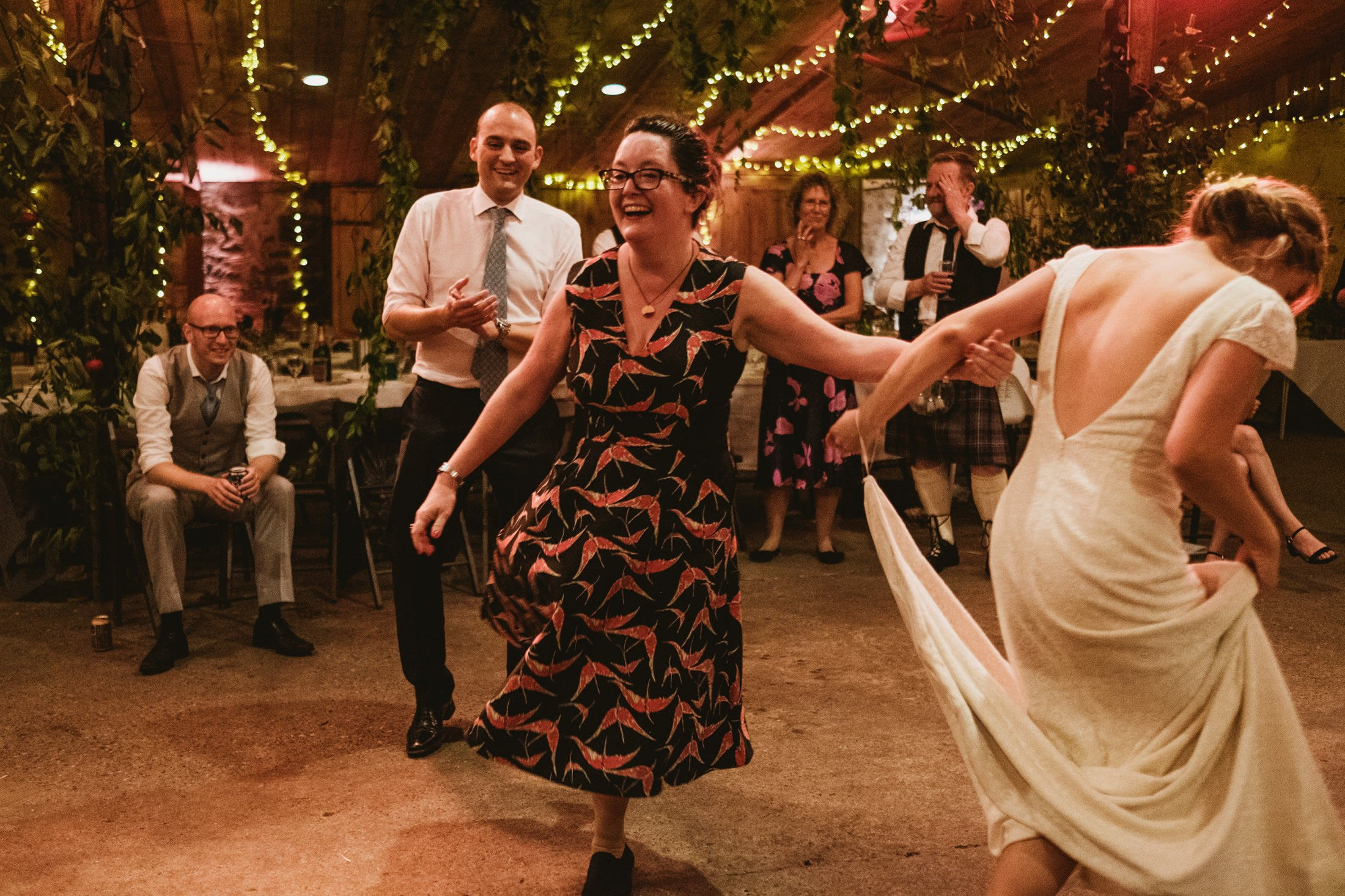 guests ceilidh dancing at Comrie Croft