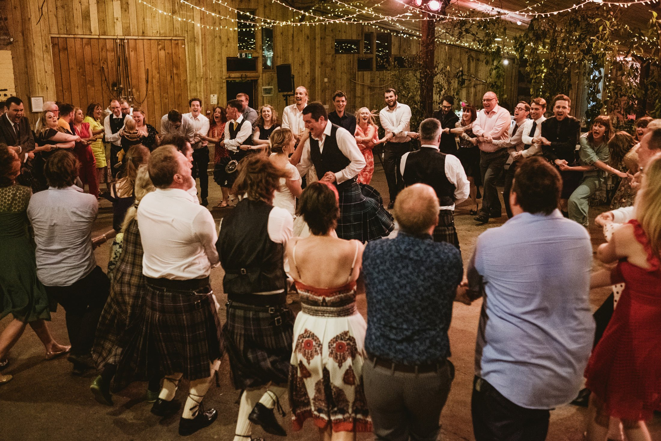 wedding guests celebrating in the barn
