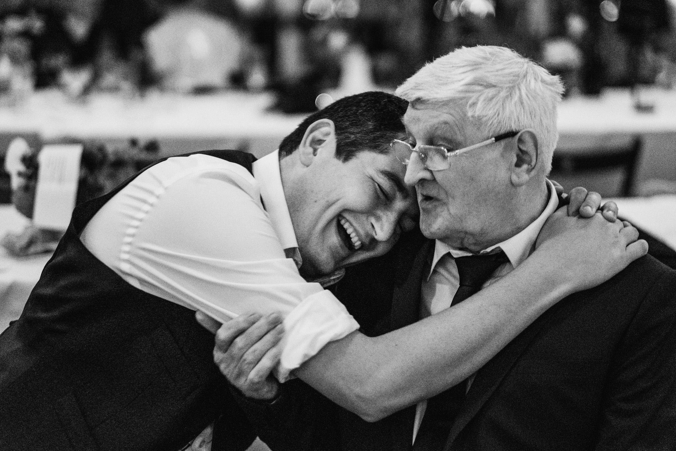 groom and grandad having a cuddle