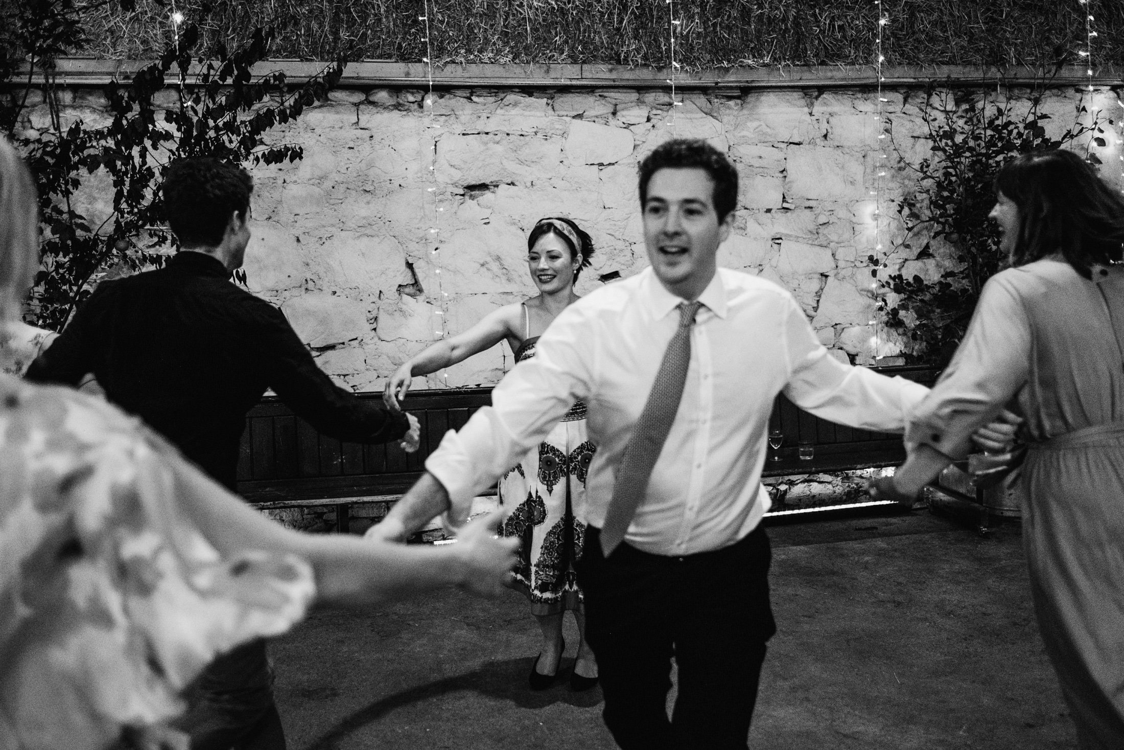 wedding guests dancing in the barn at Comrie Croft