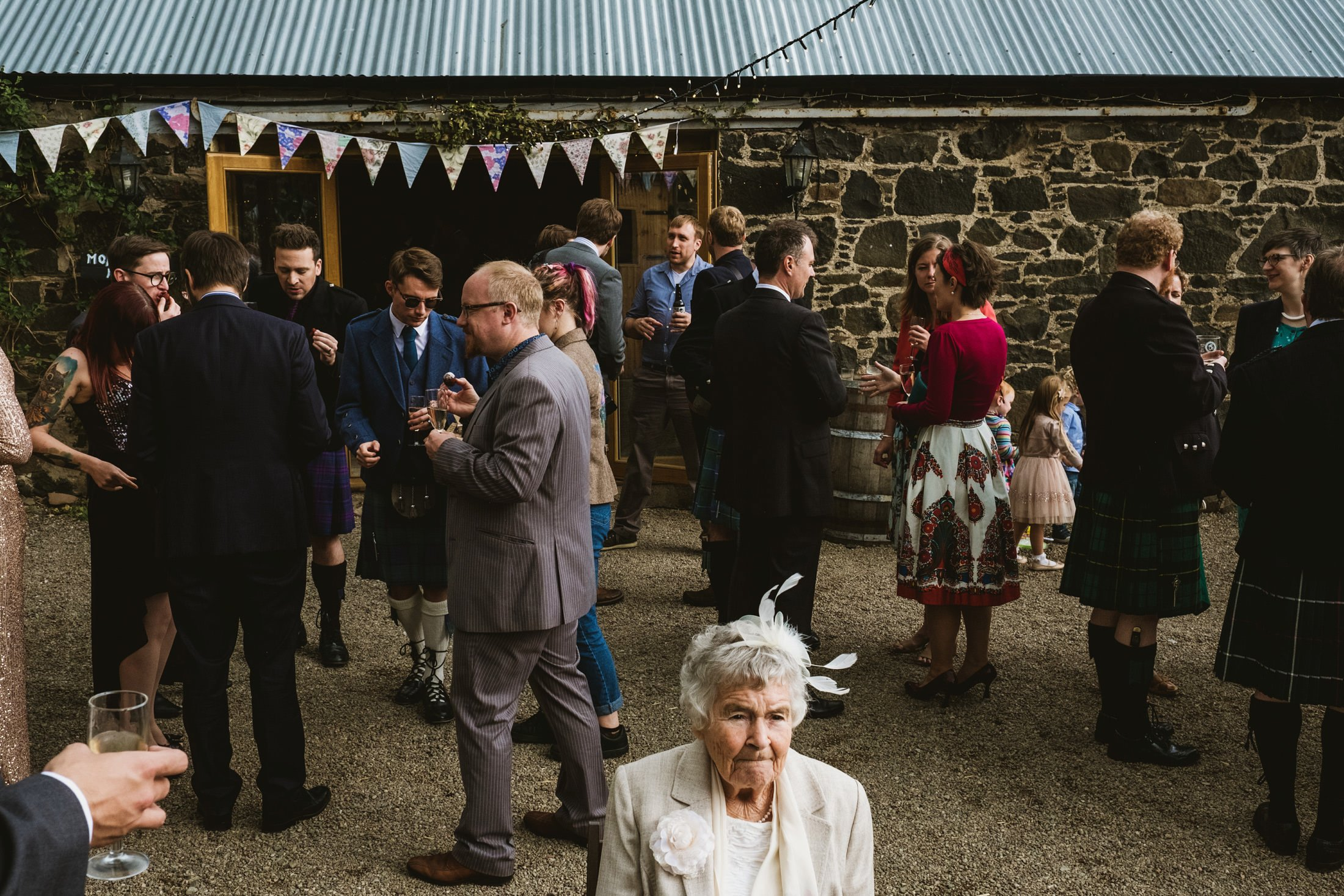 wedding reception, elderly guest in the middle of the frame