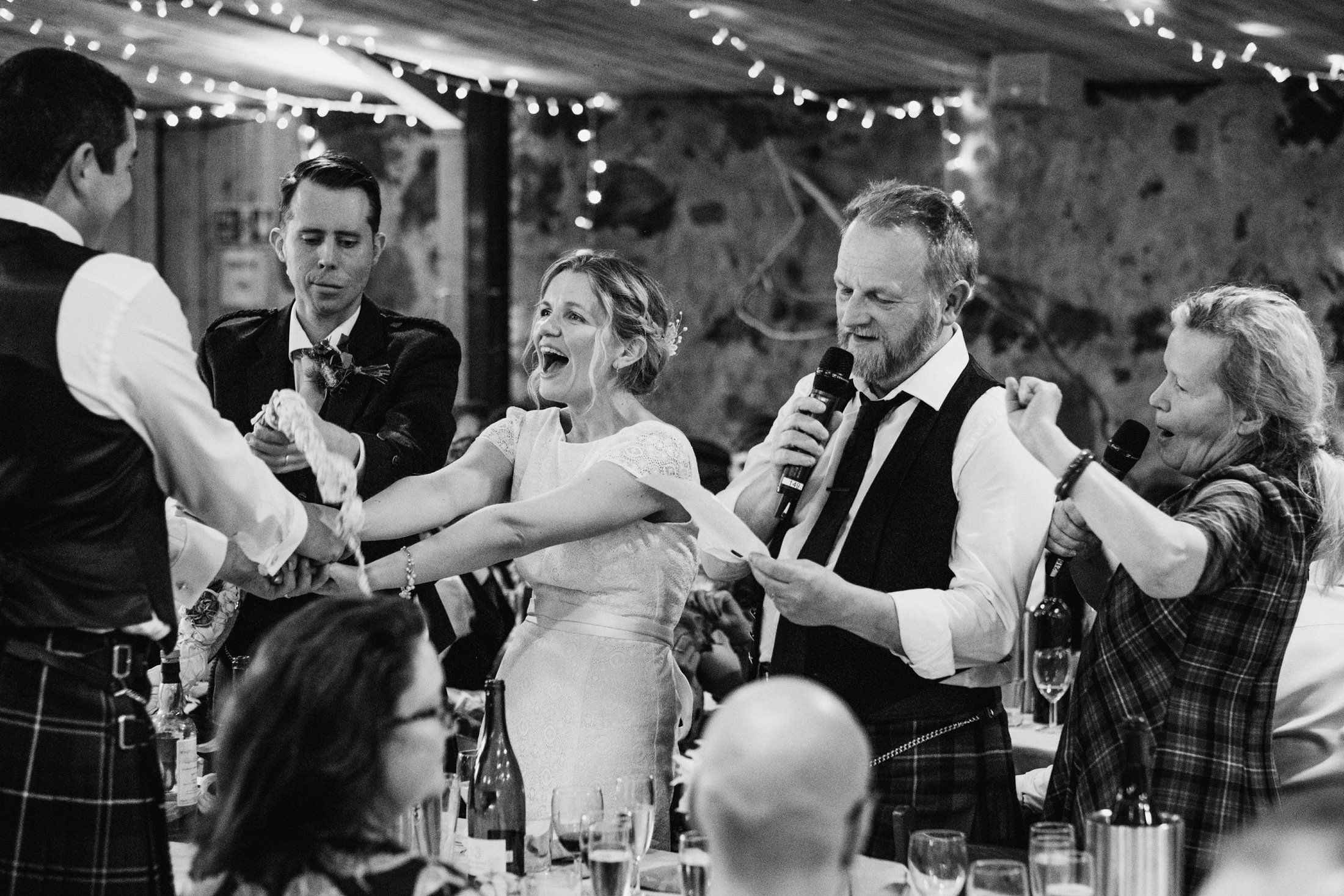 bride's dad speech, bride and groom laughing and holding hands