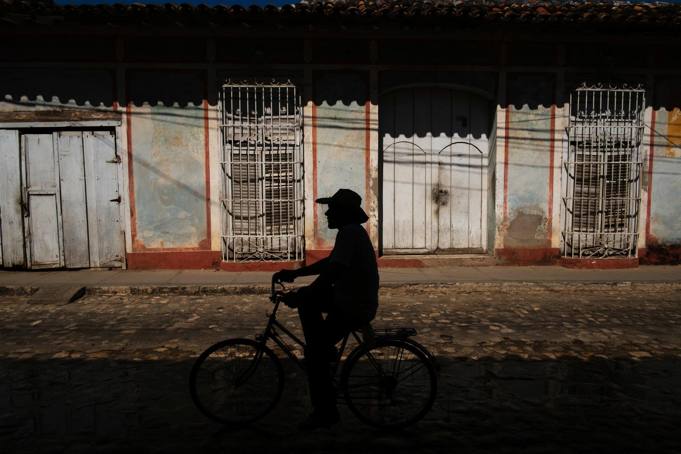 silhouette of a man riding a bike
