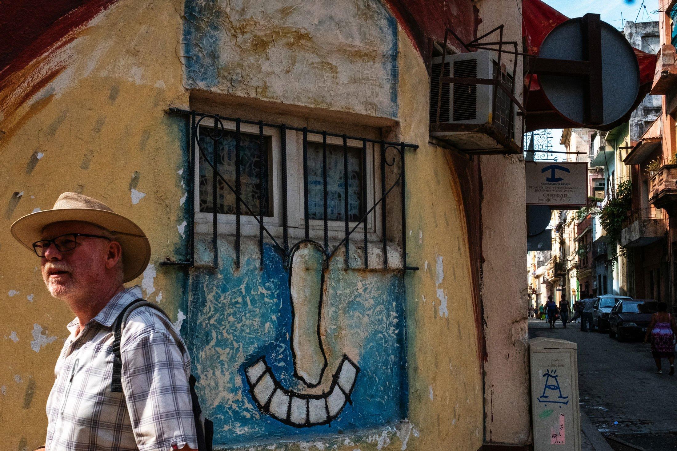 elderly man walking past with similar motif