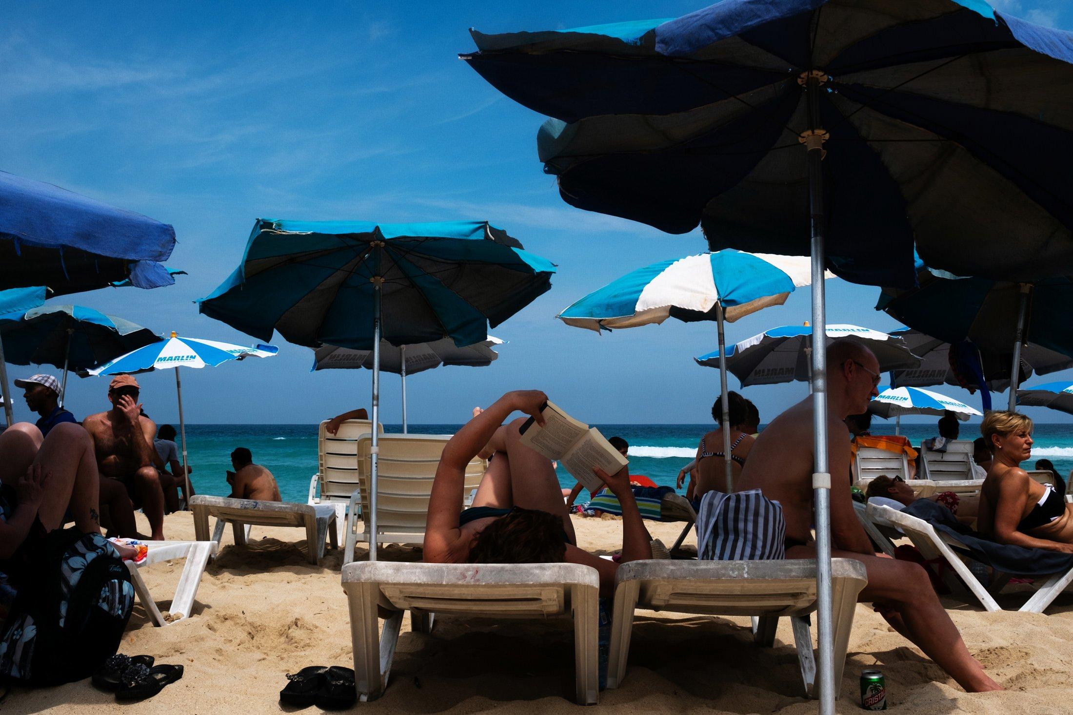 sun worshiping on a beach in Trinidad, Cuba
