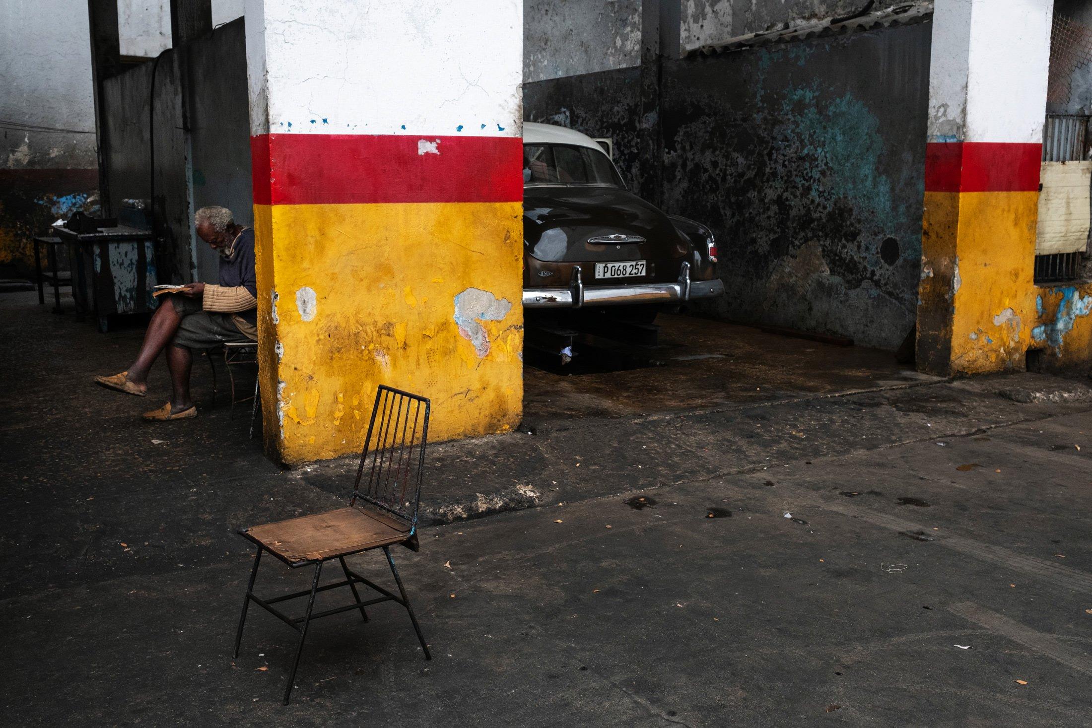 car garage with a man sitting down