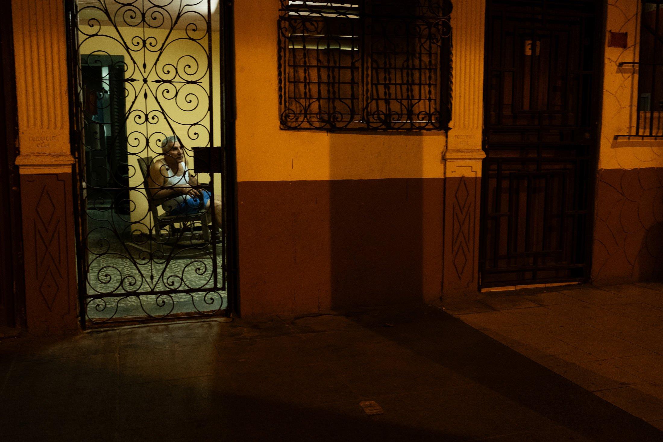 elderly woman sat in a building in Havana, Cuba