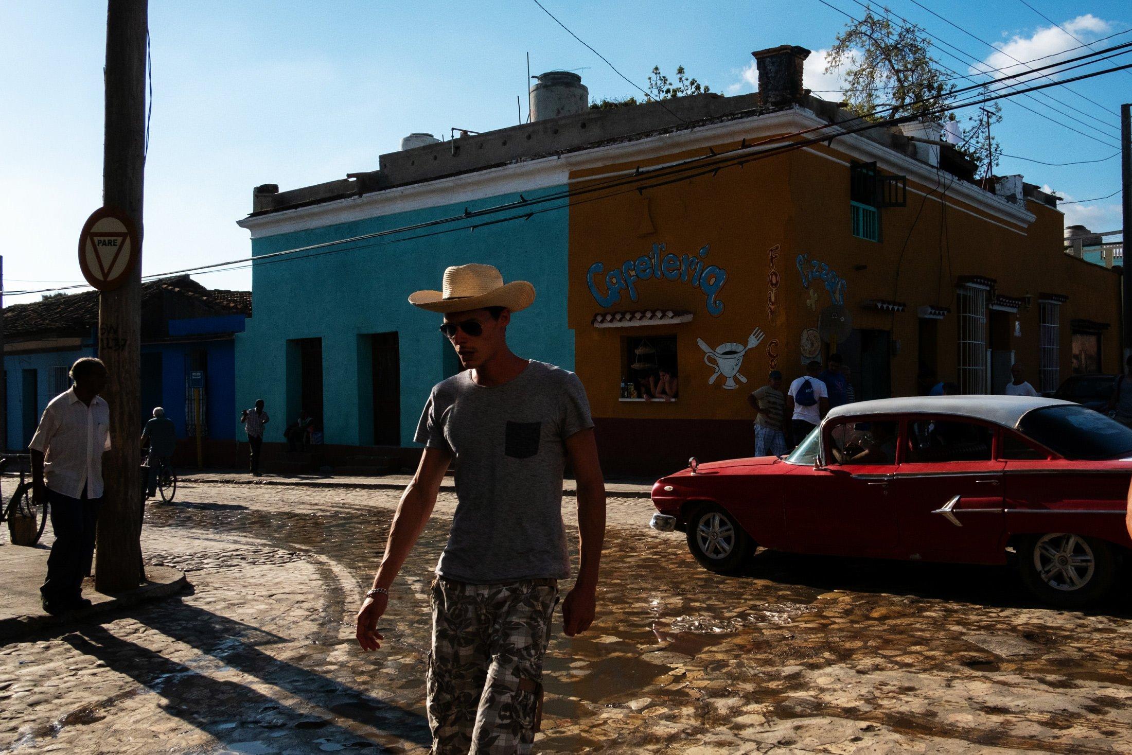 cowboy walking on the pavement in Trinidad, Cuba