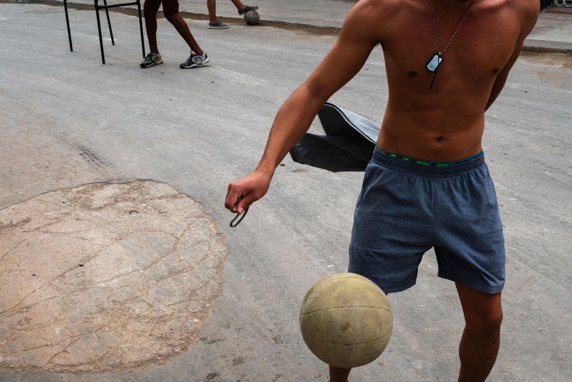 a boy kicking a football in Cuba