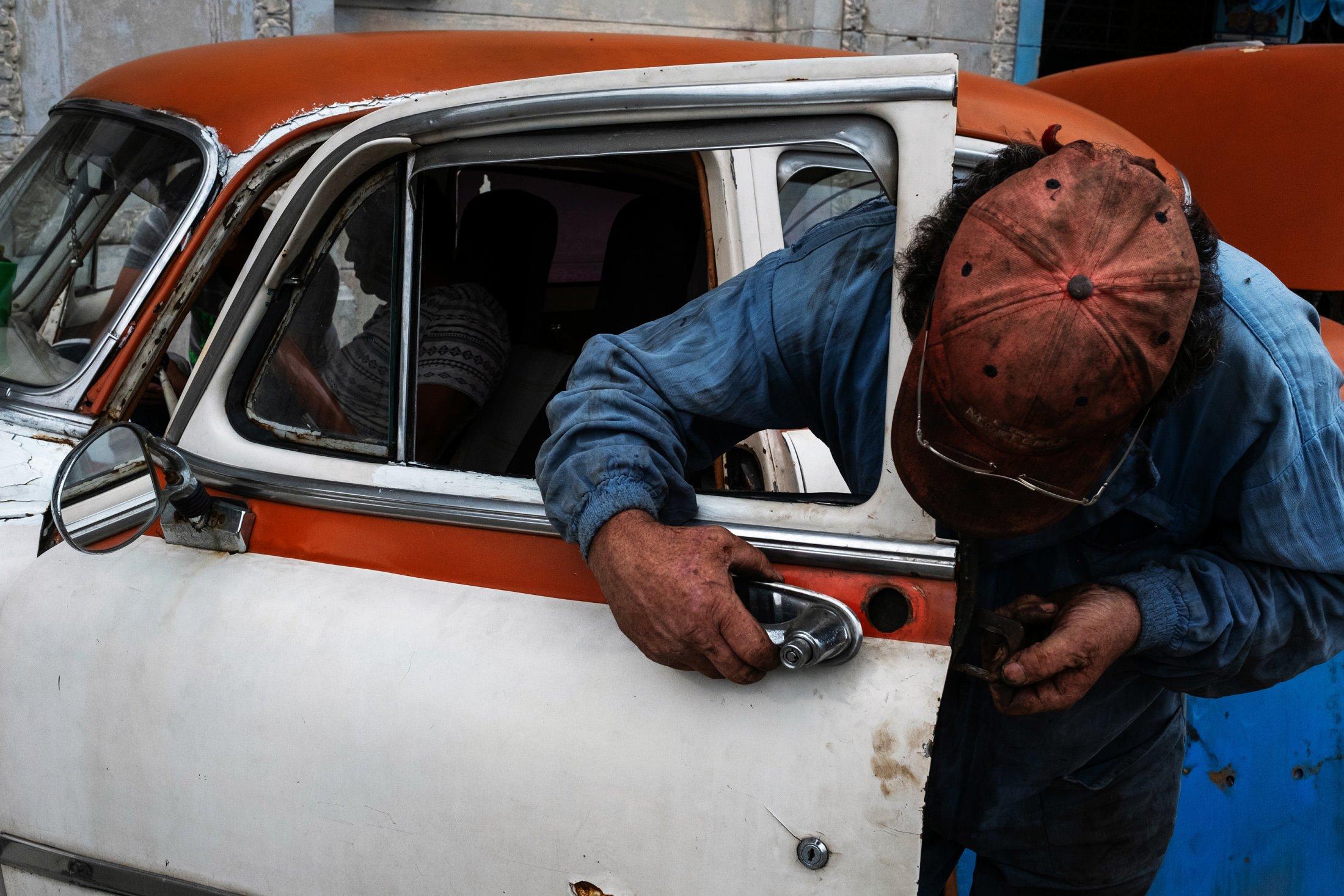 mechanic working on the handle