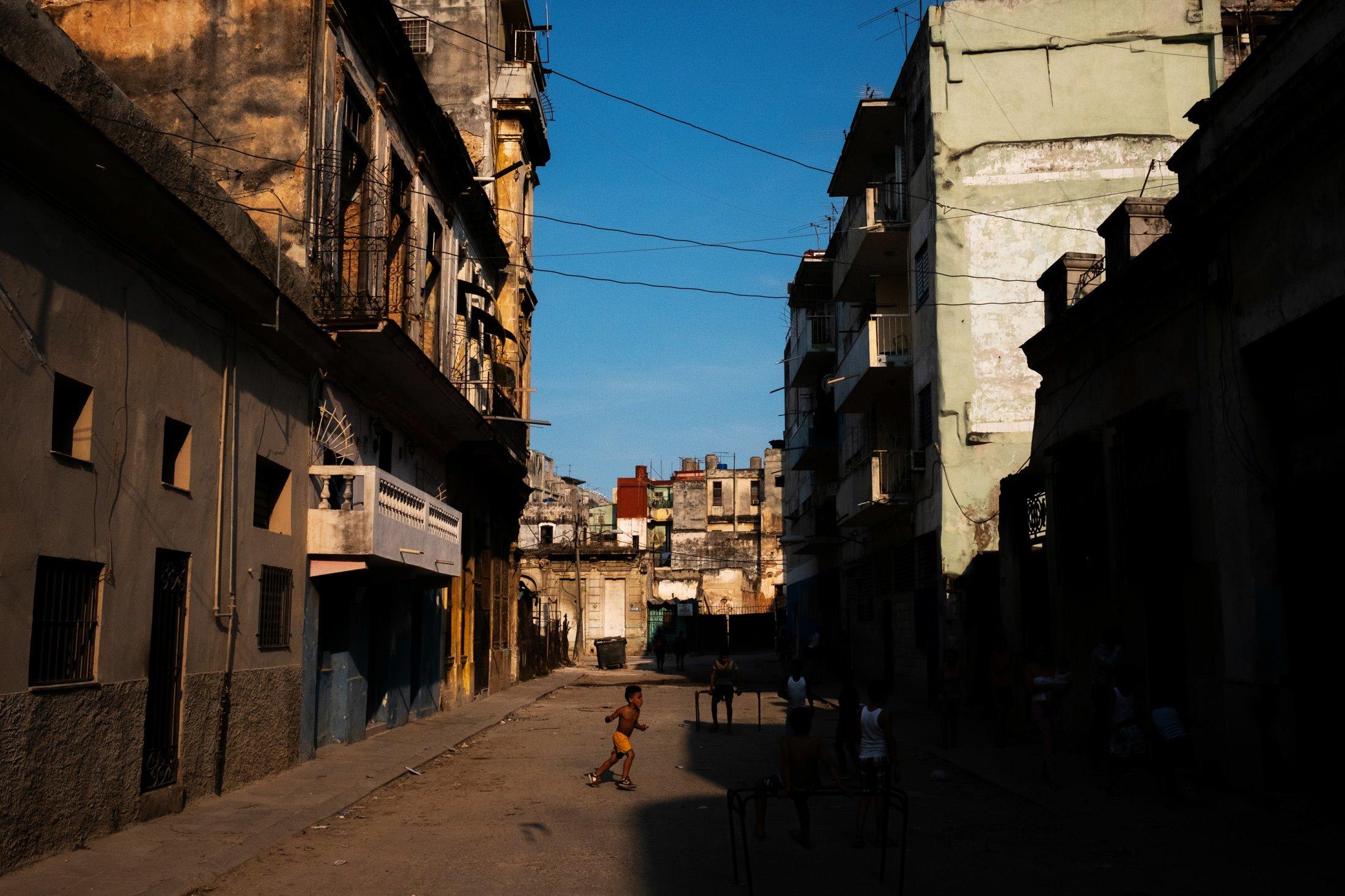 little boy running in the streets of Havana, Cuba