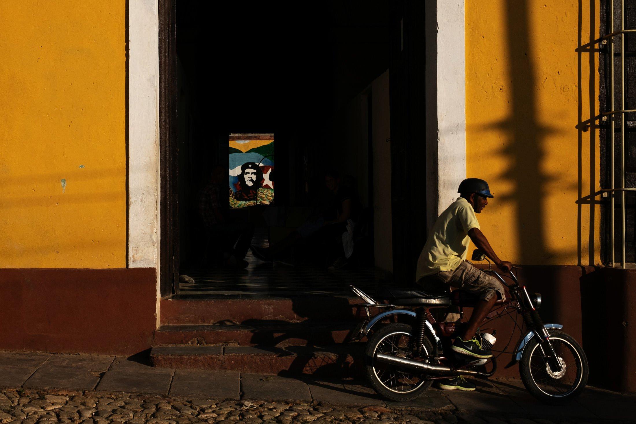 man riding a bike in evening light