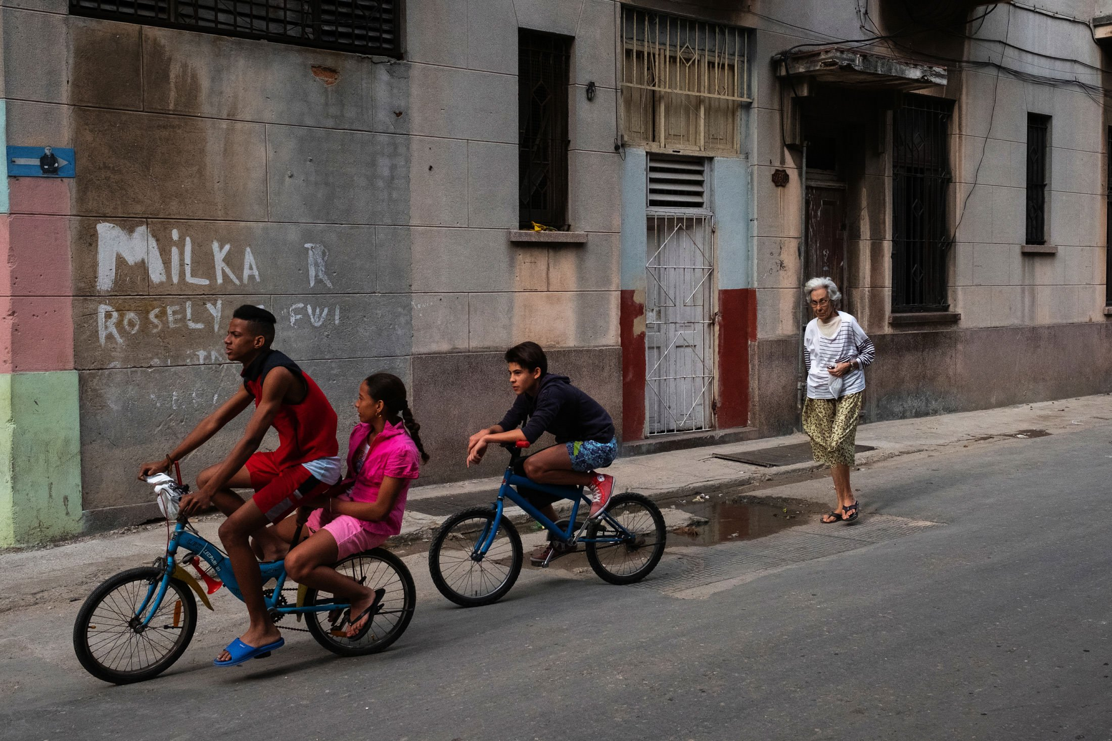 three children on bicycles in Havana, Cuba