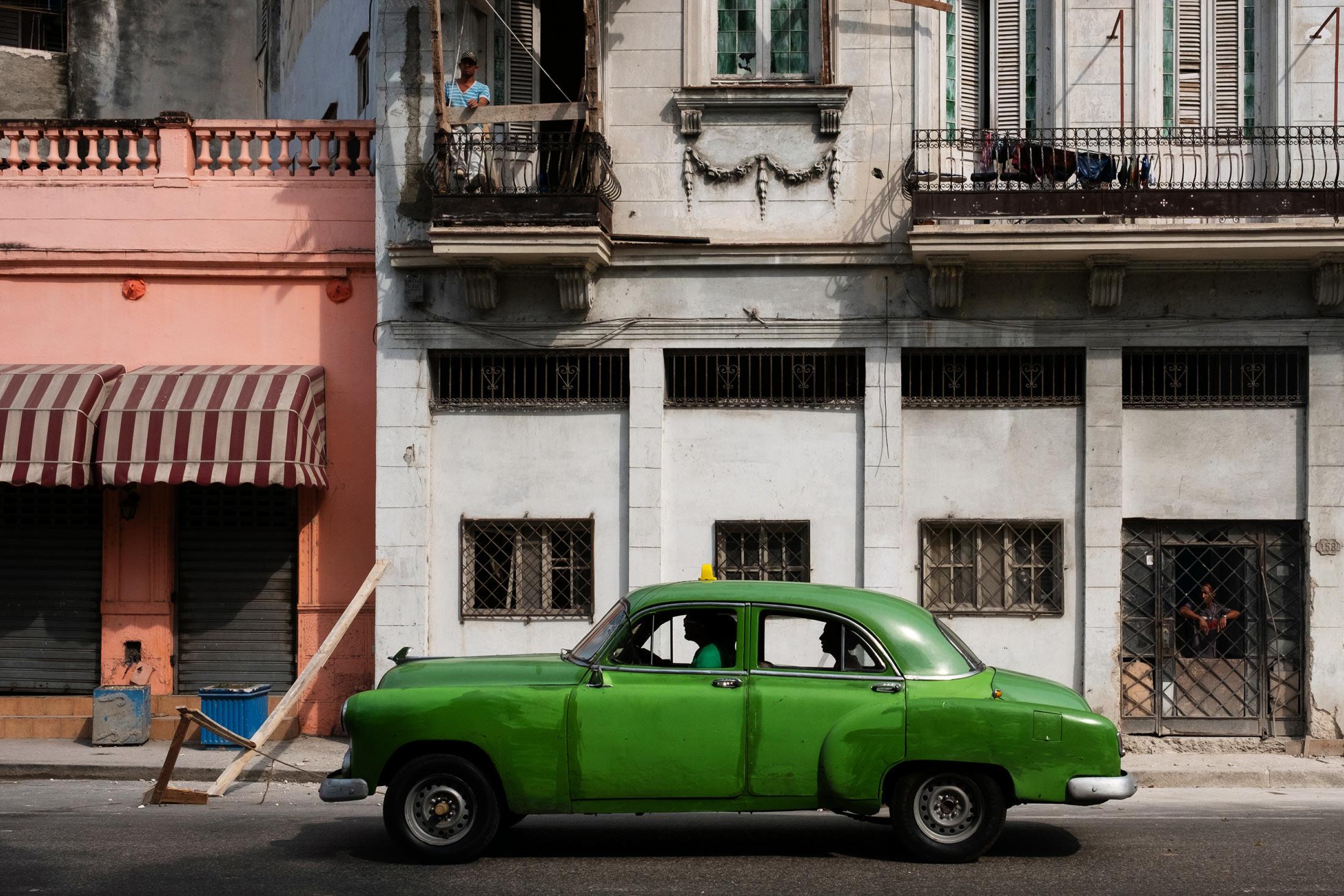 green car in a Cuban scene