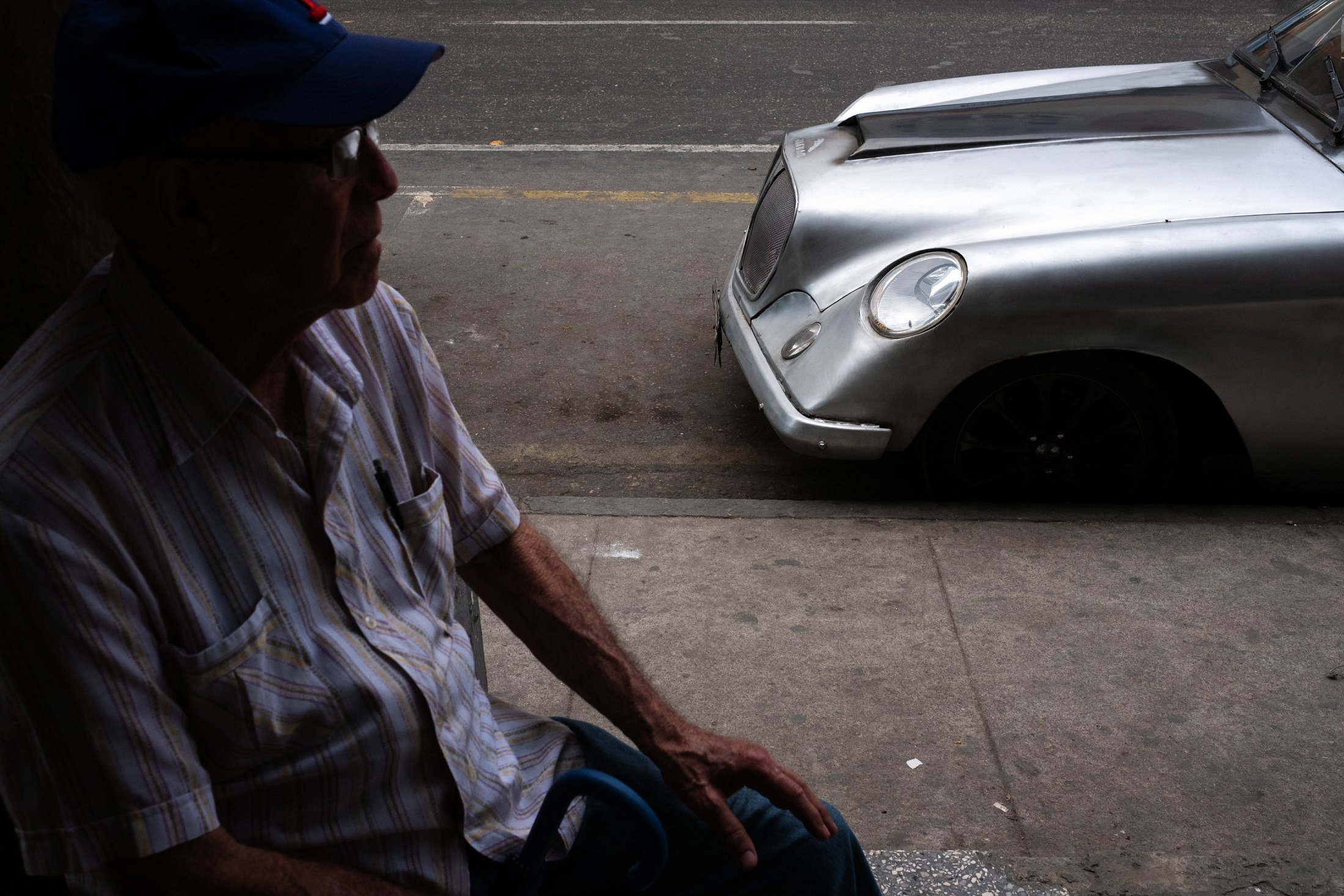 silver car with a side profile of a man