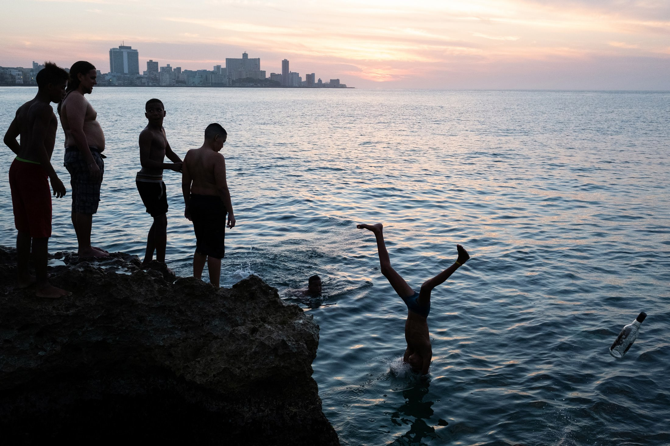 six children playing in the sea at Havana's Malecon