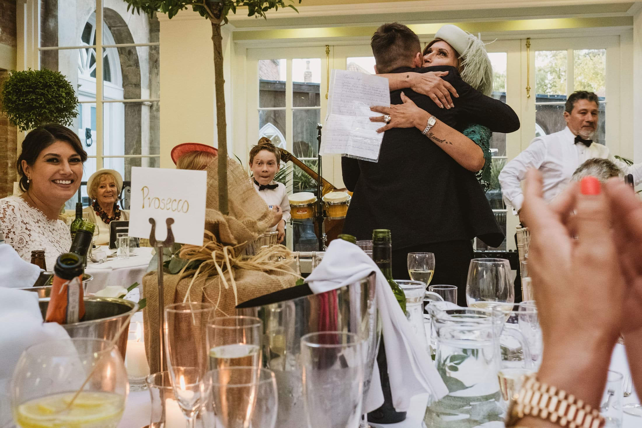 groom being hugged just as he finished his wedding speech at Goldsborough Hall
