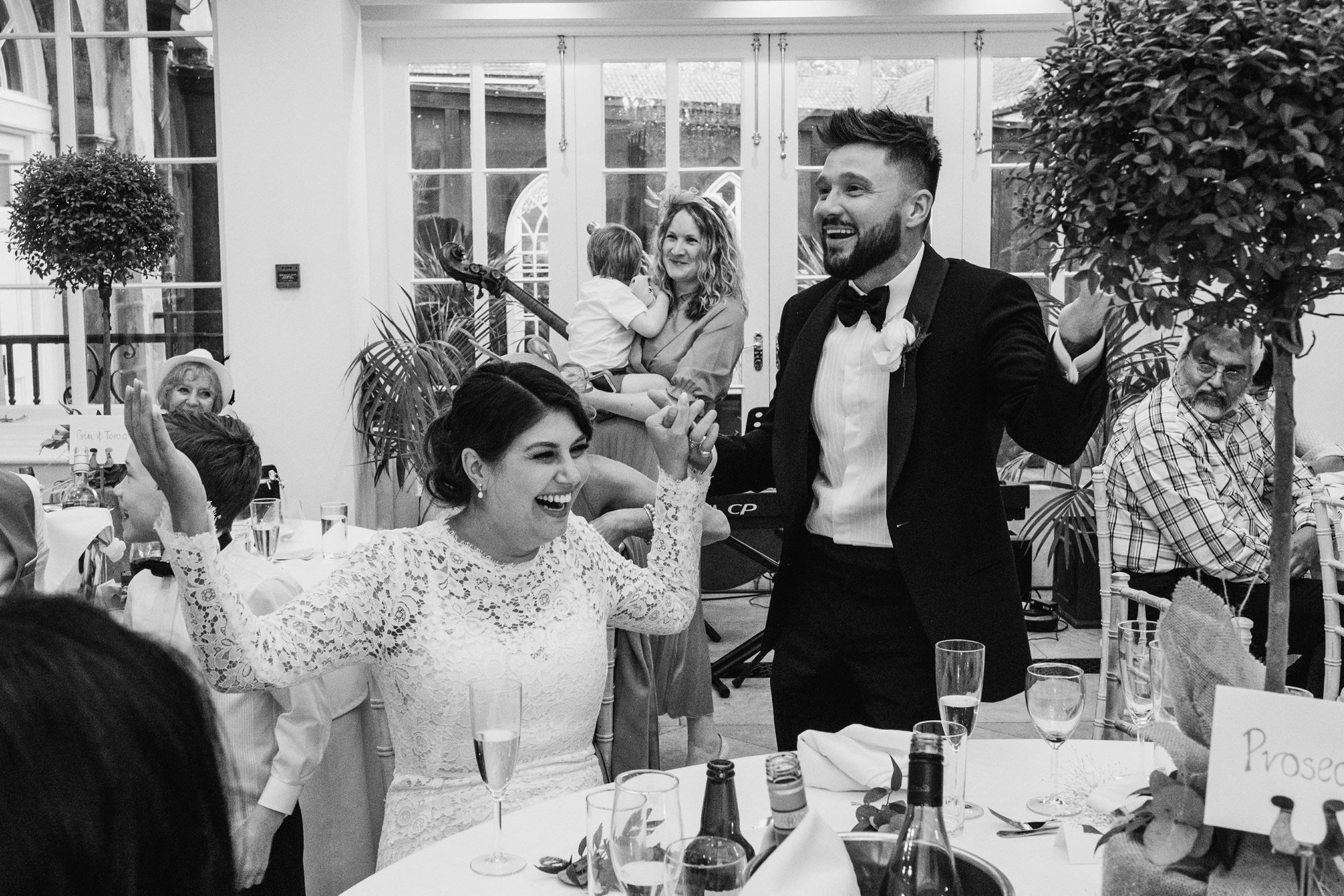 wedding speeches with the bride laughing and the groom performing at Goldsborough Hall in North Yorkshire