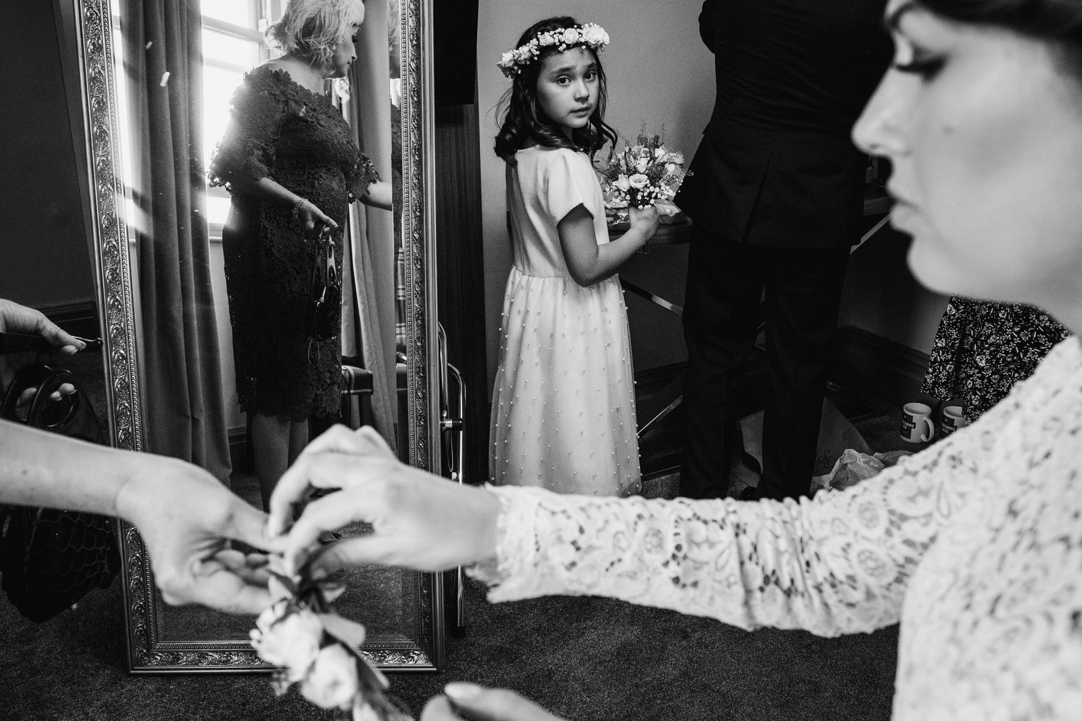 flower girl watching the bride getting ready at the Yorkshire Hotel