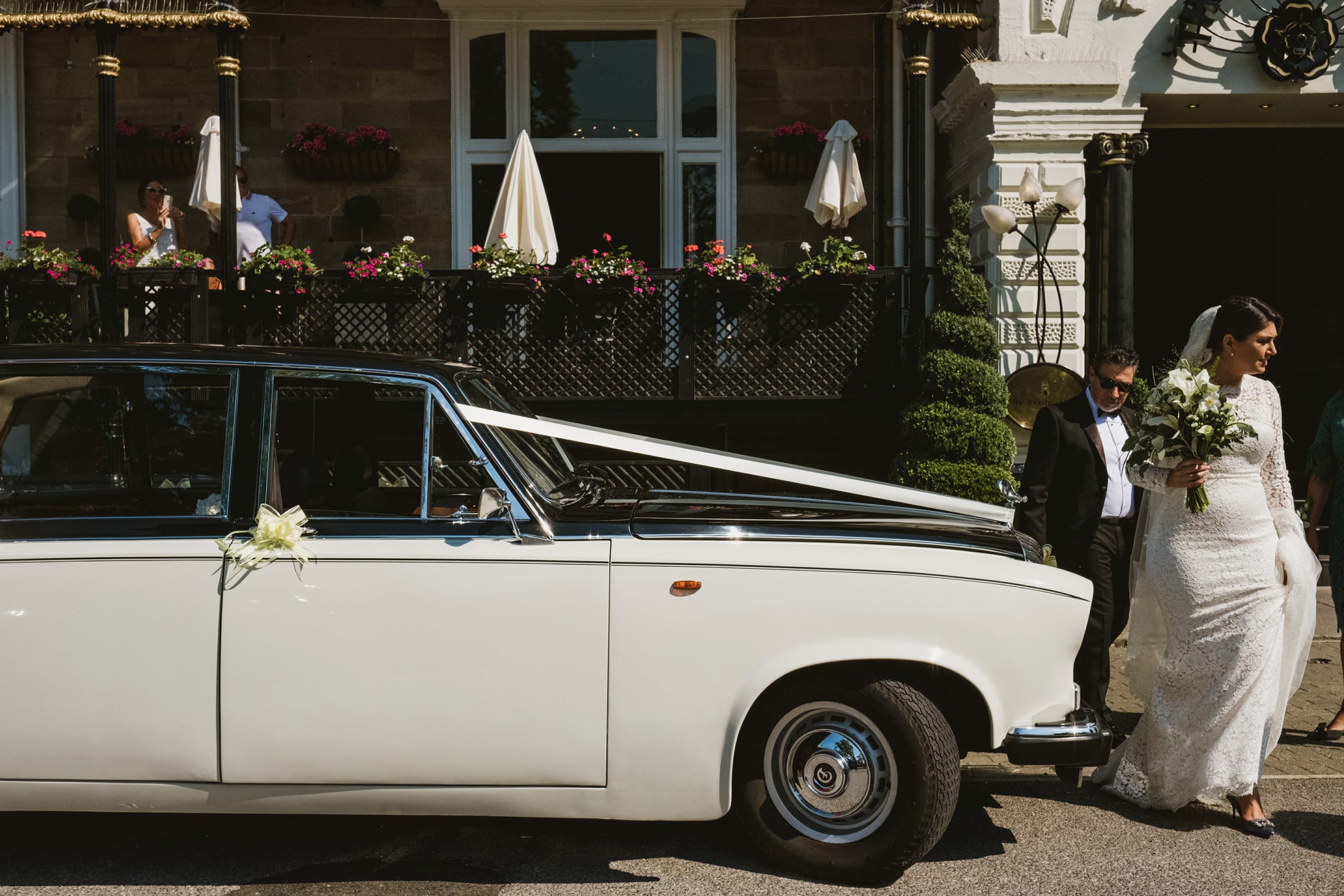 bride and dad leaving in the wedding car at the Yorkshire Hotel