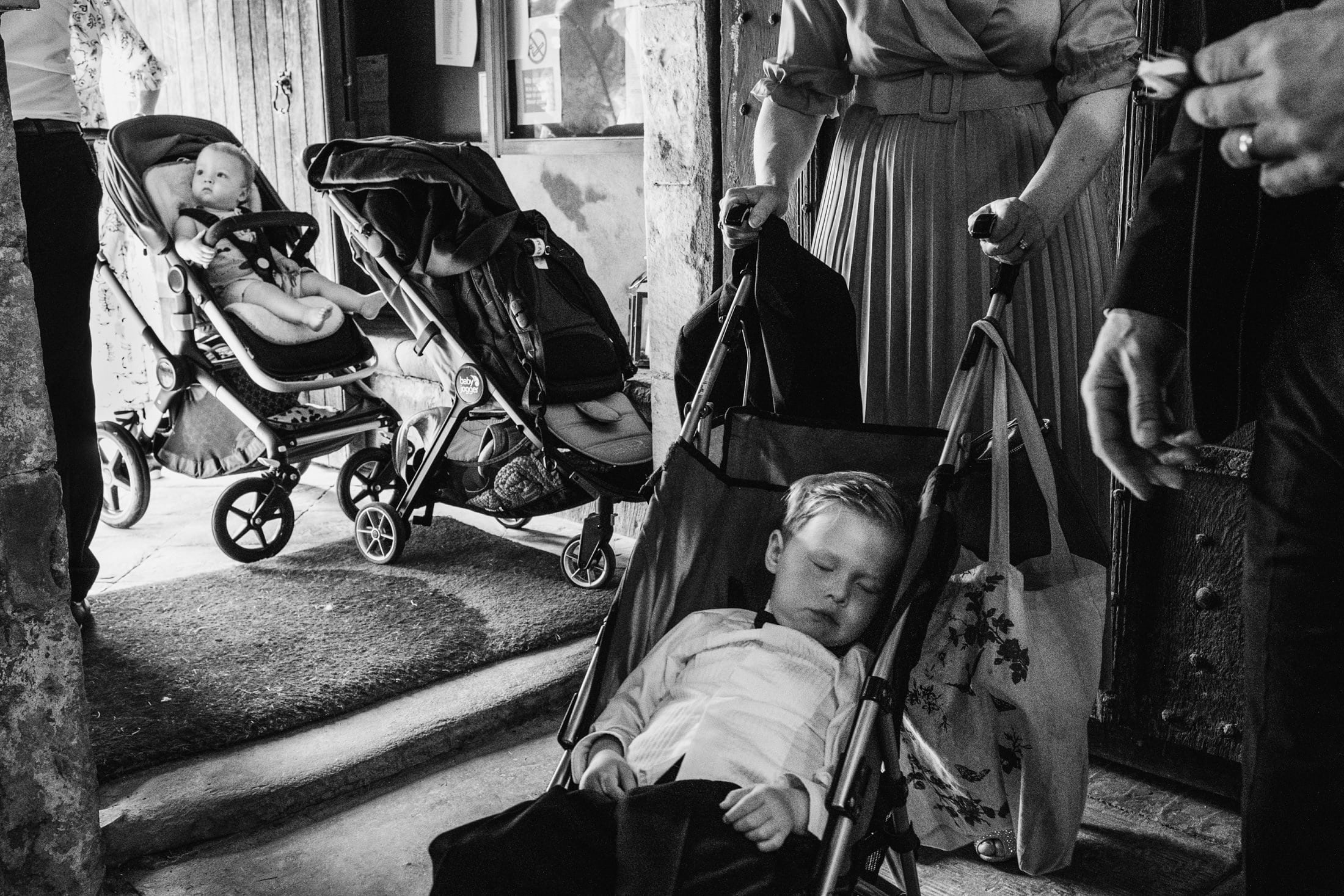 two children in prams going into the church