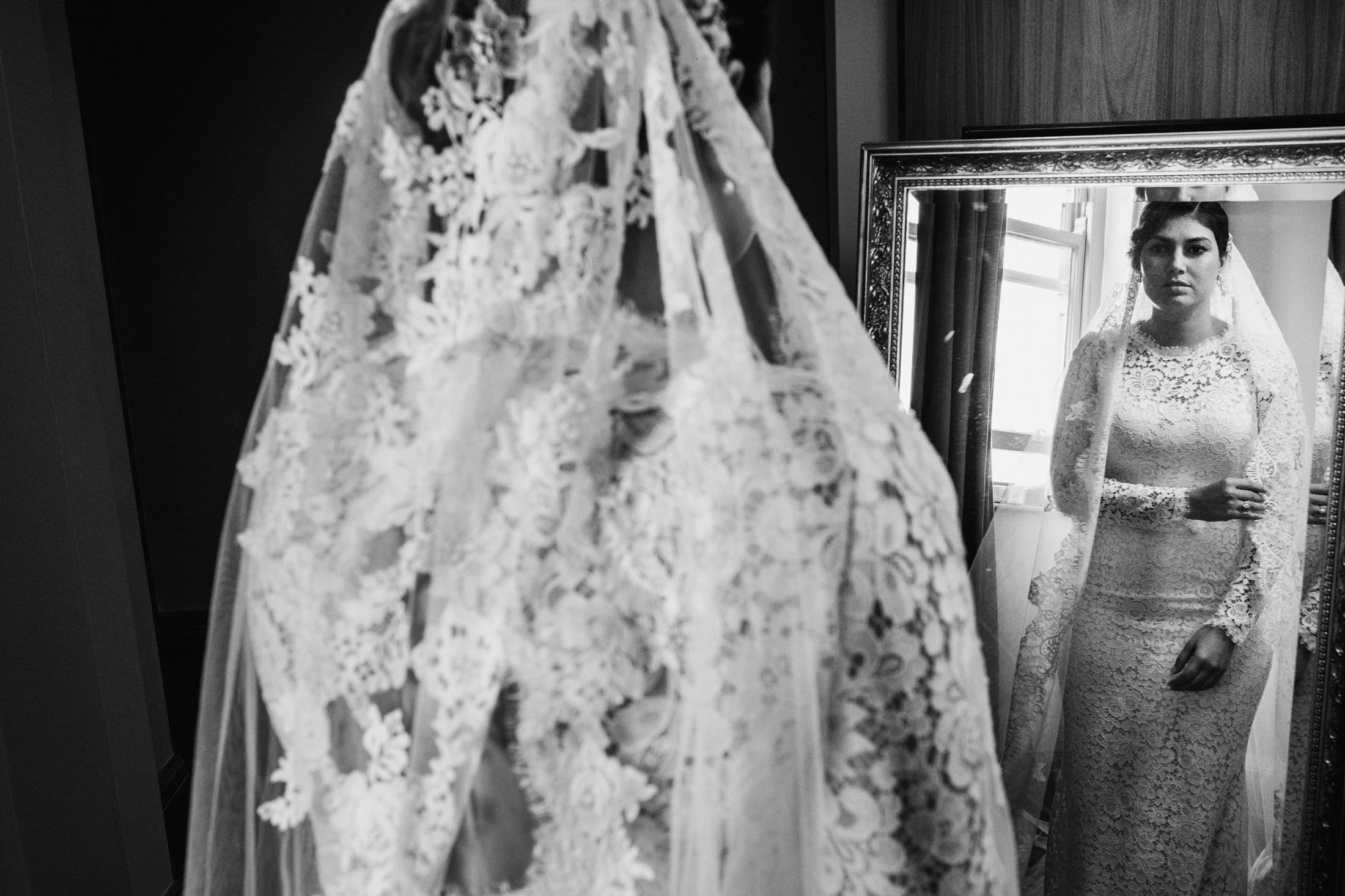 bride looking in the mirror before leaving for the wedding ceremony