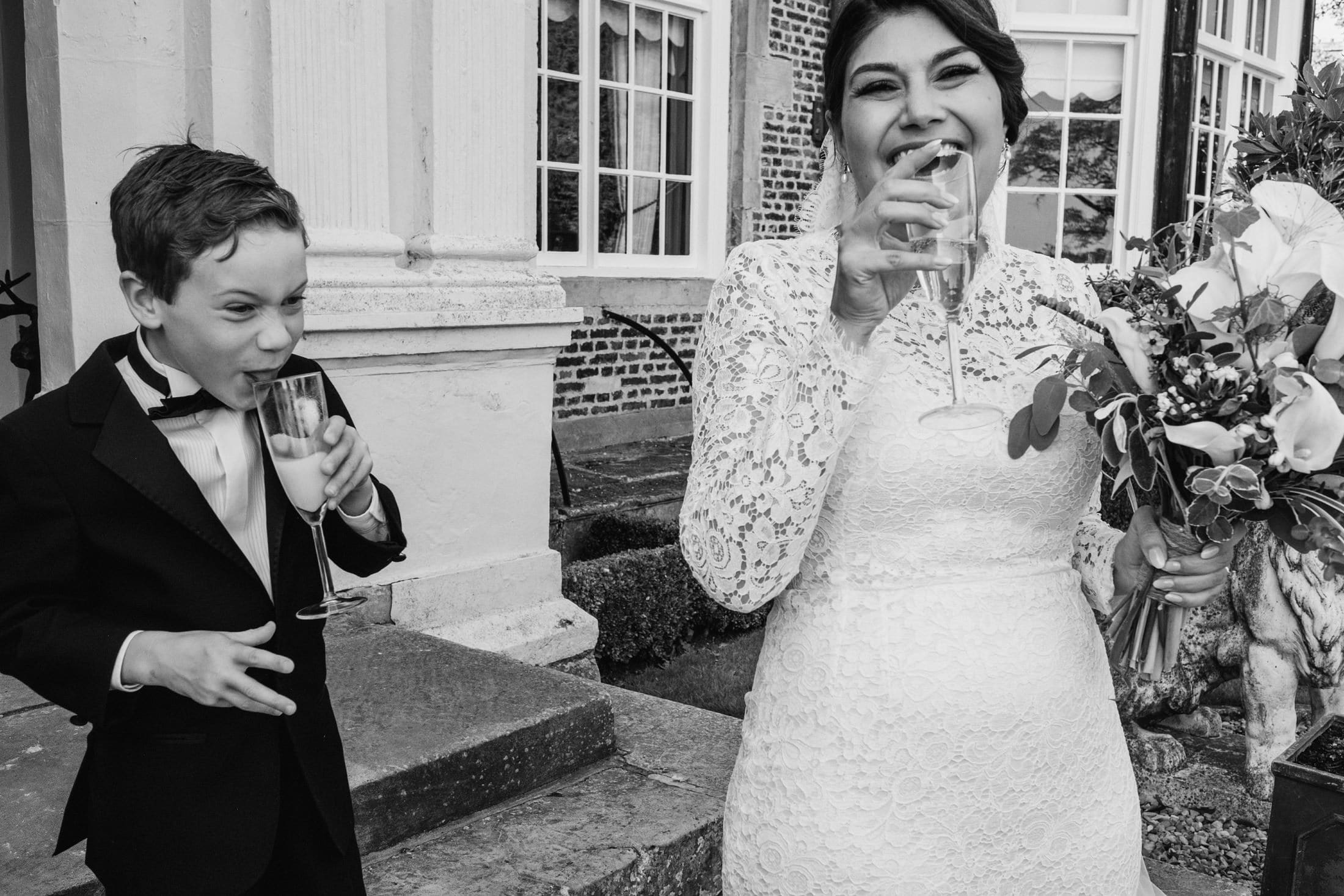 bride and page boy drinking at the reception at Goldsborough Hall