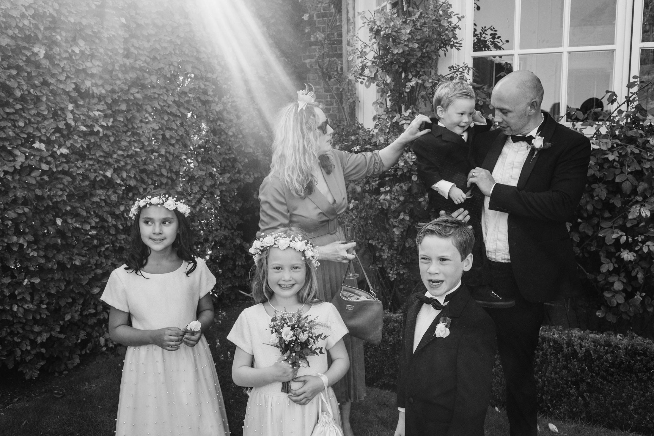 natural family group of page boys and flower girls with parents at Goldsborough Hall