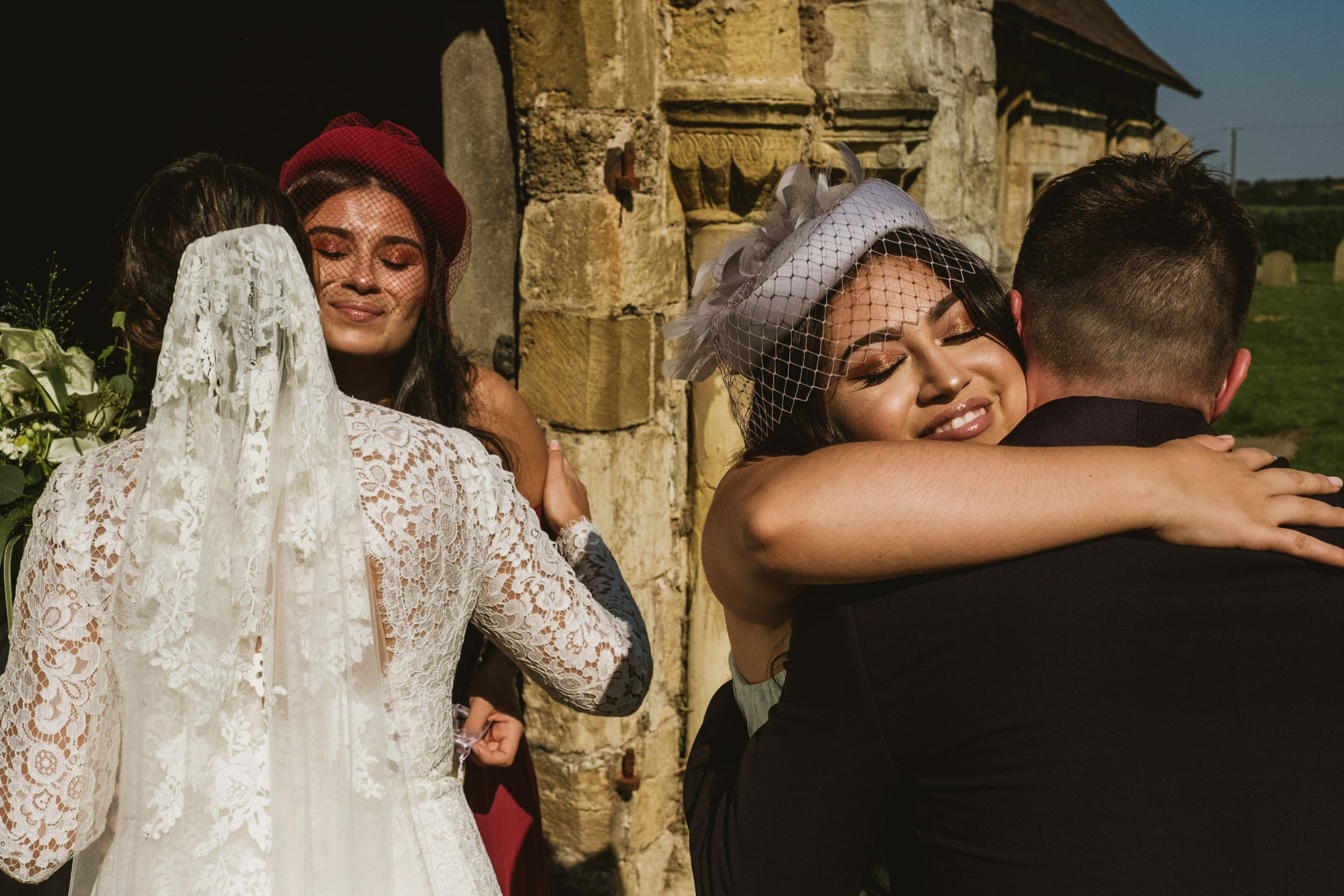 bride and groom hugging guests in Yorkshire