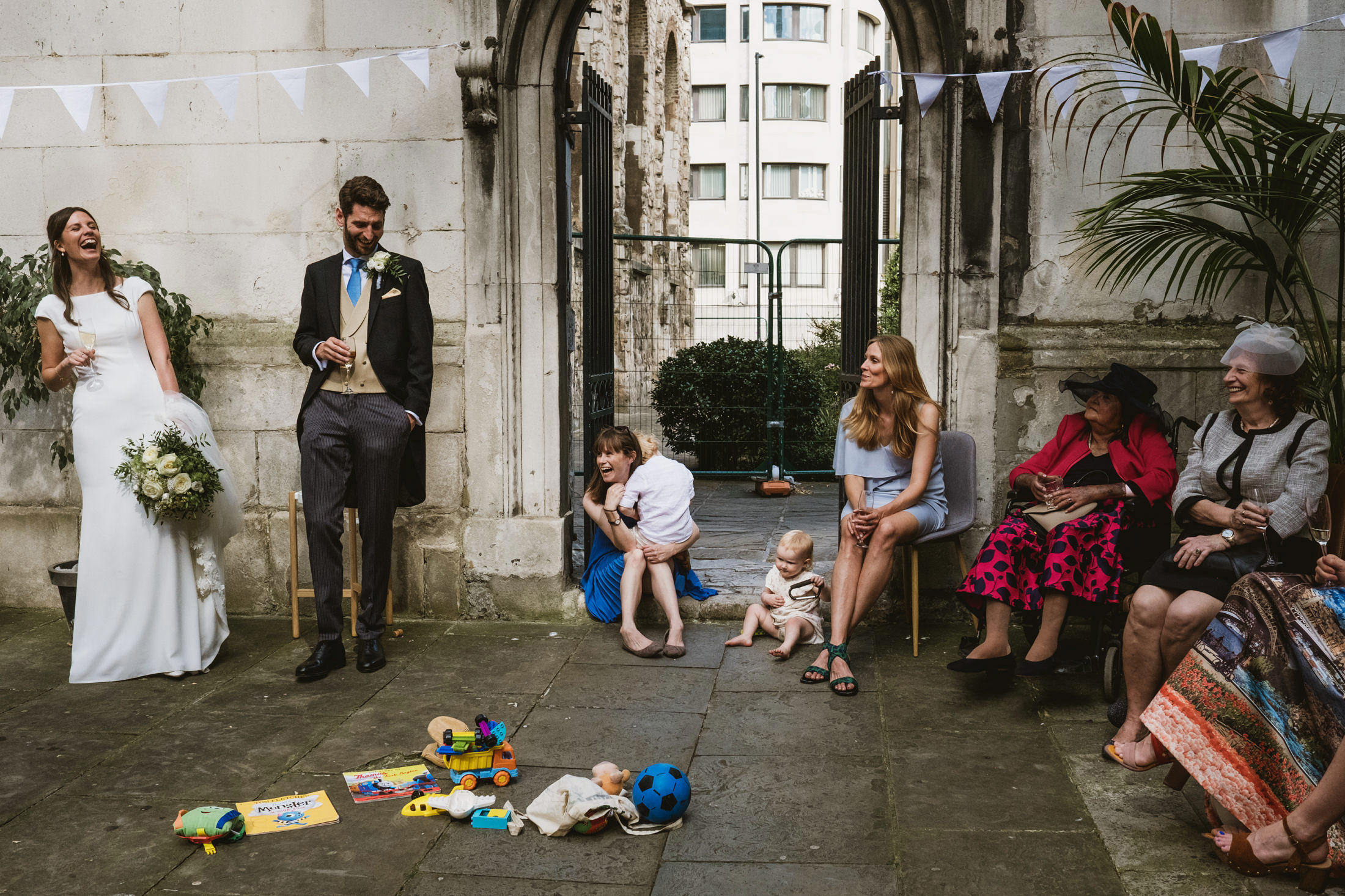 Guests enjoy a joke together during a covid-19 miniaturised wedding in London
