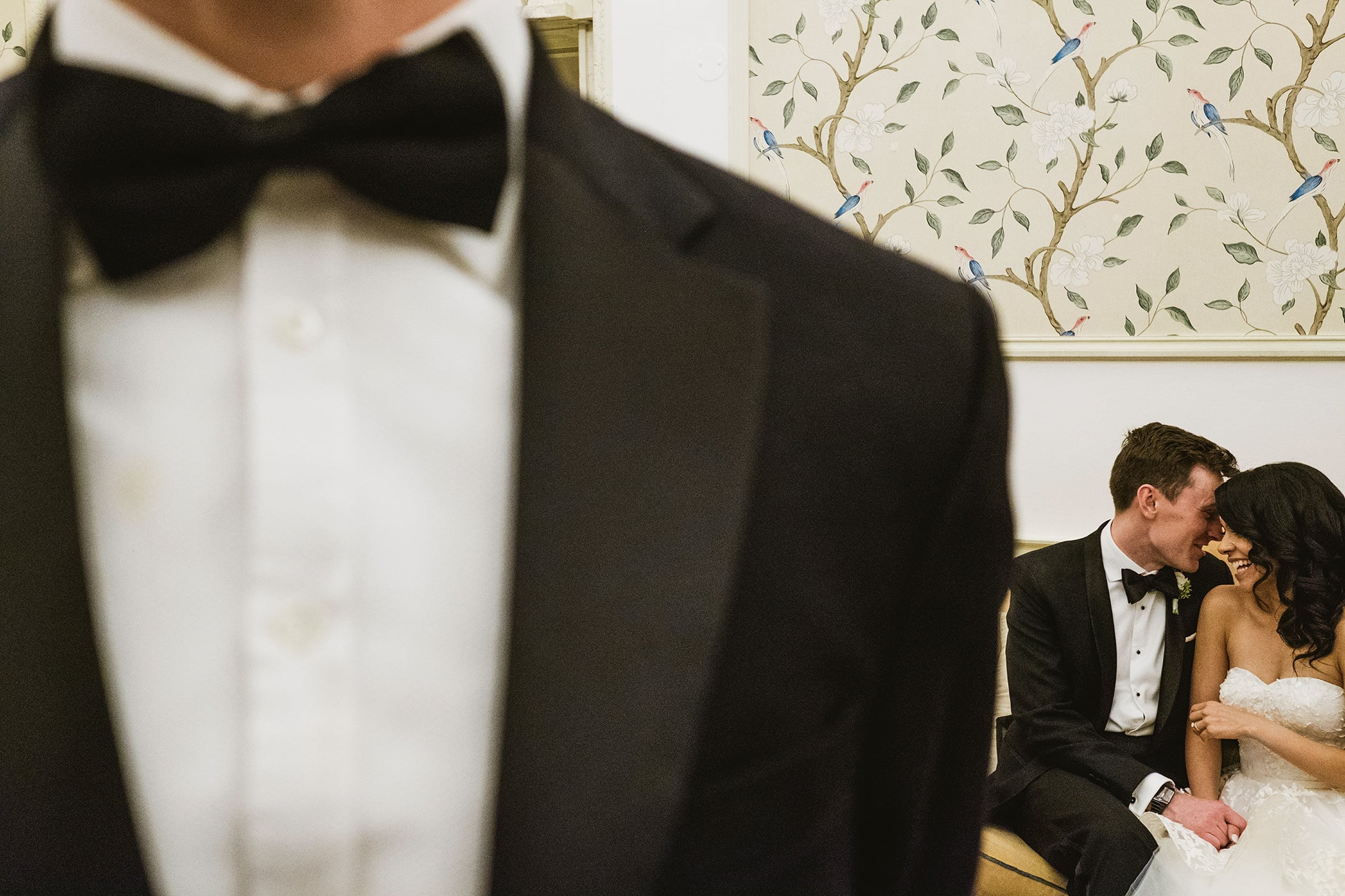 Hedsor House Wedding Photography London. Bride and groom portrait with bow tie foreground.