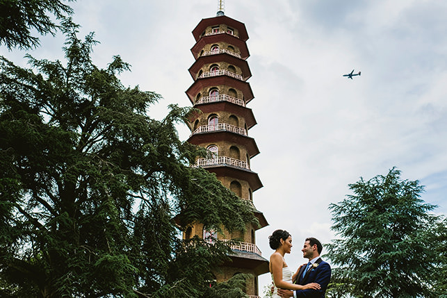 Kew Gardens bride and groom. Airplane passing over the Kew Gardens Tower.