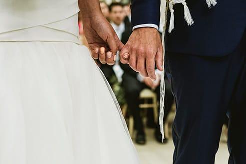 Kew Gardens wedding photographer. Bride and groom holding hands.