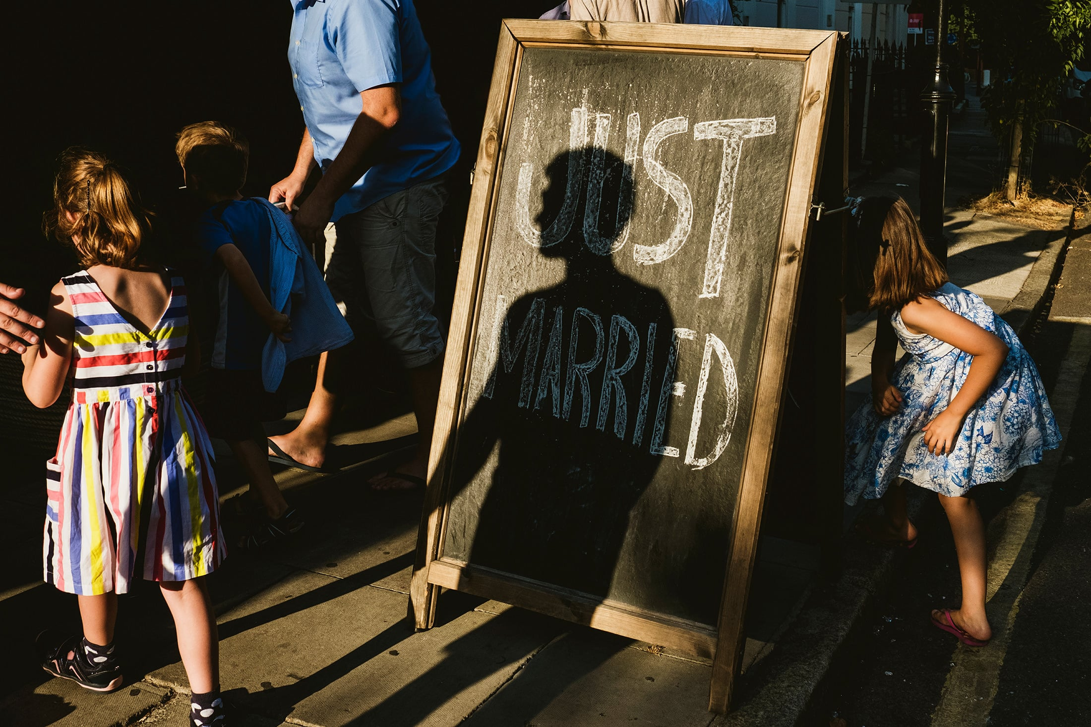 light and shadow on a Just Married chalk sign