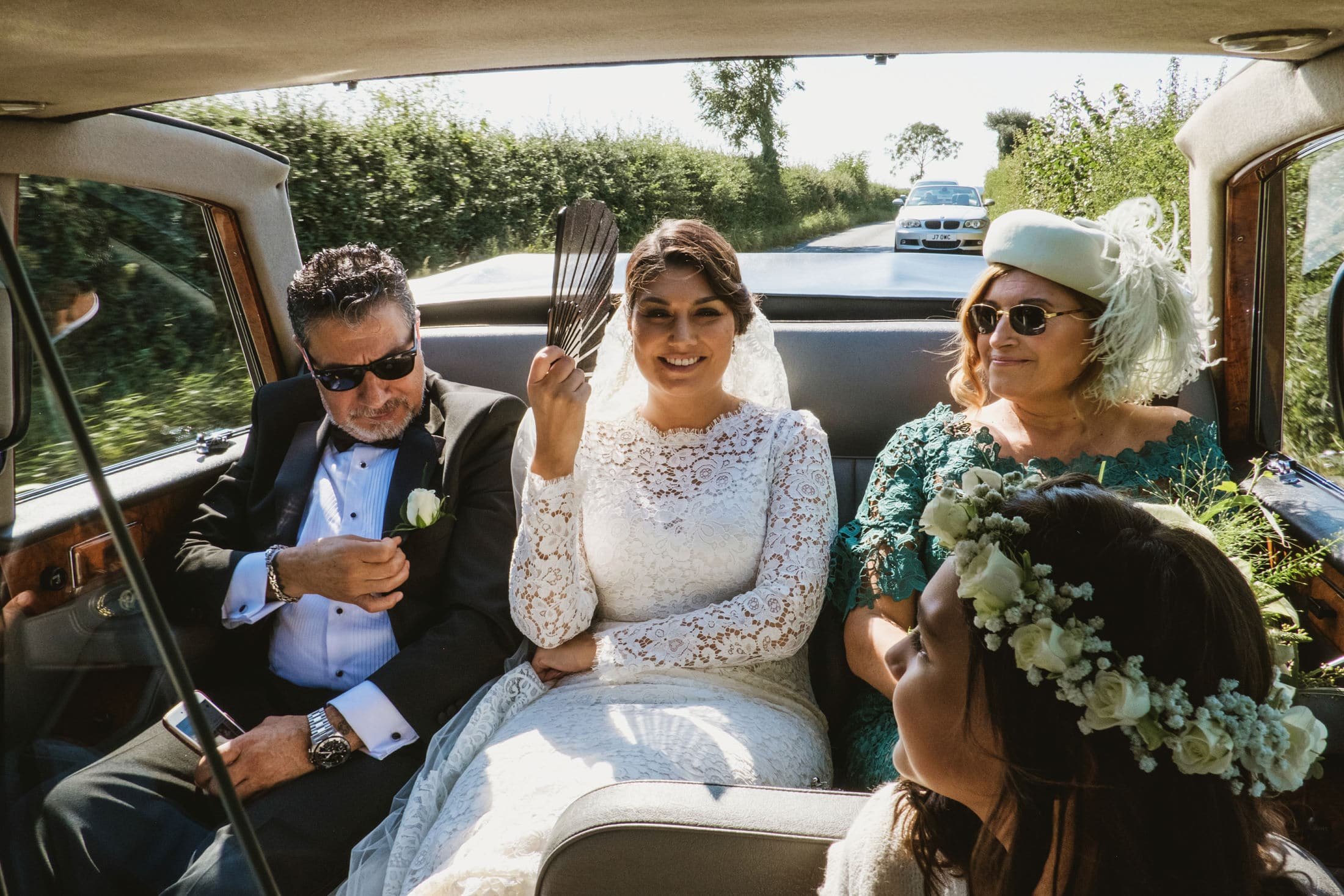 bride, bride's parents and flower girl in car